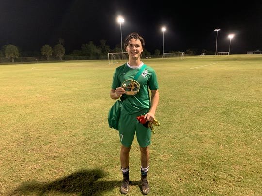 Ethan Blakely poses for a picture following his team's win against the North, 4-3. Blakely had many key saves late in the game to keep the game tied.