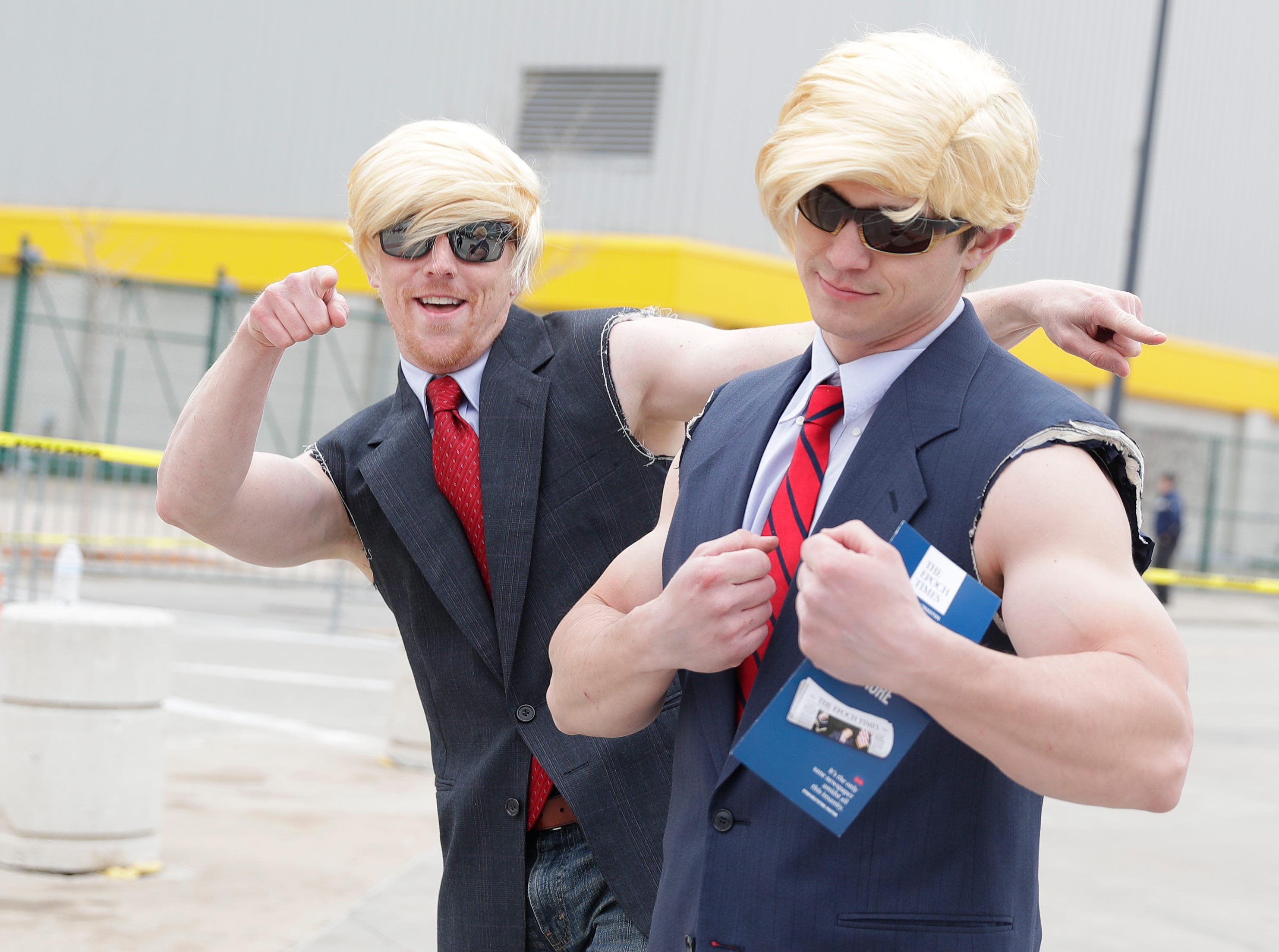 Supporters dressed like President Donald Trump walk to his rally on April 27, 2019 at the Resch Center in Ashwaubenon, Wis.