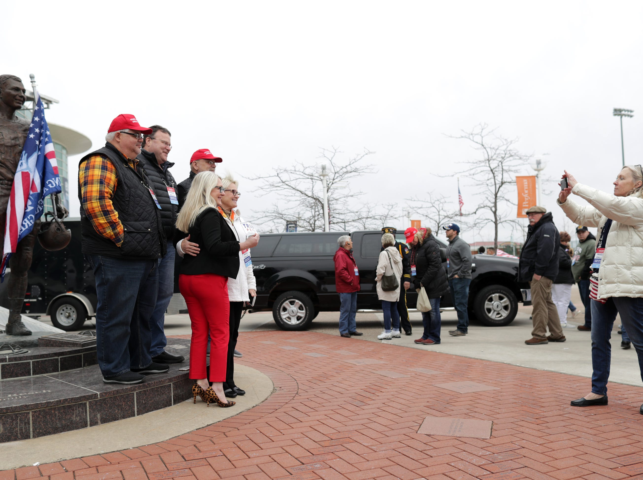 Supporters take a photo with a statue of Bart Starr before President Donald J. TrumpÕs Make America Great Again Rally on Saturday, April 27, 2019, at the Resch Center in Green Bay, Wis.