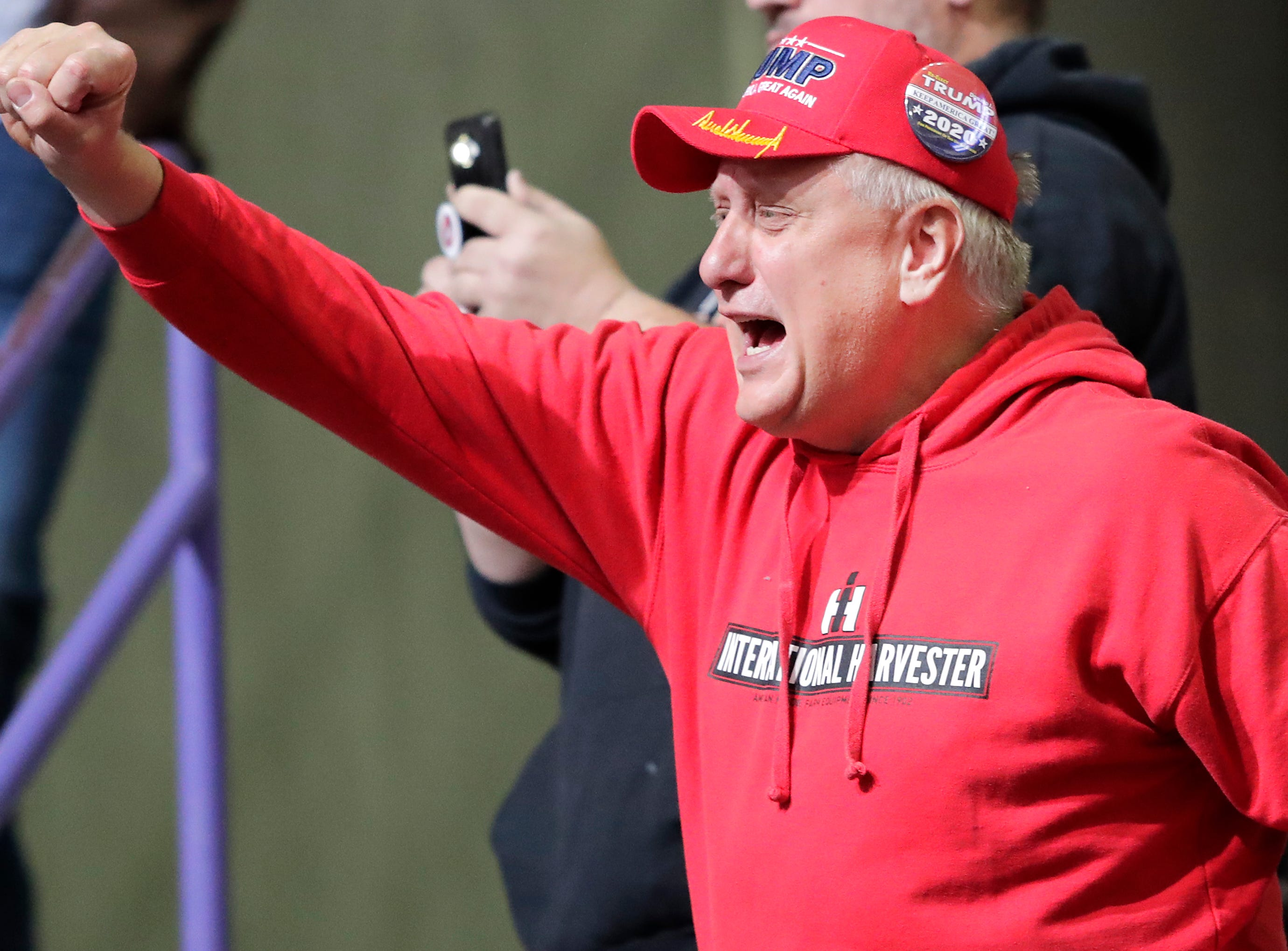 A supporter  cheers during a President Donald J. Trump's Make America Great Again Rally on Saturday, April 27, 2019, at the Resch Center in Green Bay, Wis. Wm. Glasheen/USA TODAY NETWORK-Wisconsin.