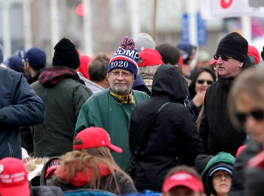 Supporters wait in line, some all night, before President Donald Trump's campaign rally on Saturday at the Resch Center in Ashwaubenon.