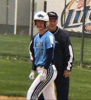 Great Falls High senior Sarah Conway gets instructions from first base coach Don Meirhoff during Saturday's first game of a doubleheader against Bozeman at Multi-Sports. The Bison won 23-0 in five innings.