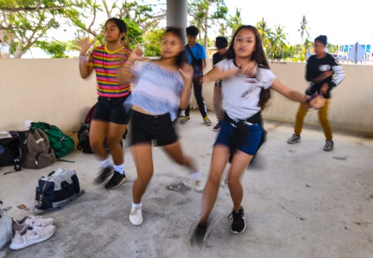 Dancers practice their moves prior to a dance contest held during Sanctuary Incorporated of Guam's annual Youthfest at the PacFest Pavillions in Hagåtña on Saturday, April 27, 2019.