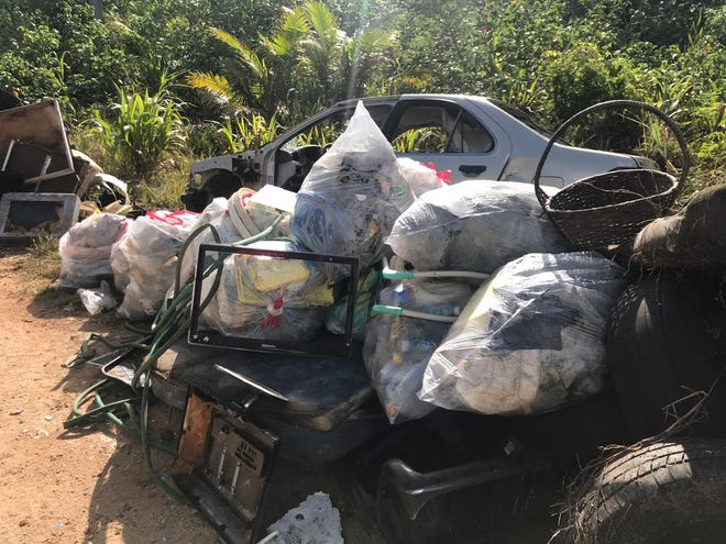 Sen. Clynt Ridgell's office , local organizations and organizations representing island nations of the Freely Associated States work to pick up trash in Dededo along the Okkodo pipeline on April 27, 2019.