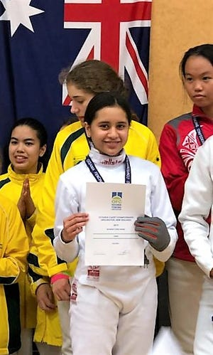 Guam fencer Anica Camacho, 14, is shown on the podium after winning a team bronze at the Oceania Fencing 2019 Cadet Championships in New Zealand on April 26.