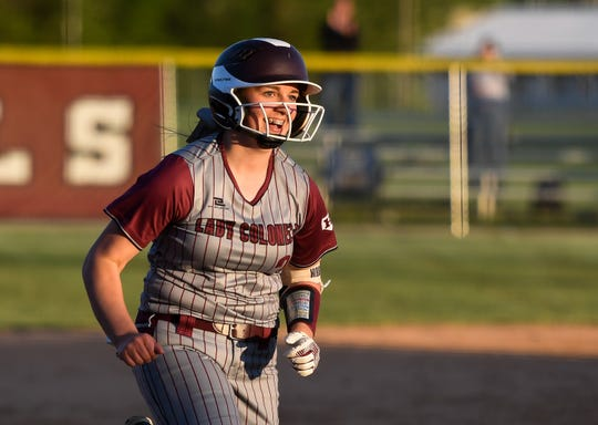 Henderson County's Julianna Hibbs (21) smiles as she runs toward home plate after hitting a grand slam home run the fifth inning as the Webster County Lady Trojans play the Henderson County Lady Colonels at Henderson's North Field Friday, April 26, 2019.
