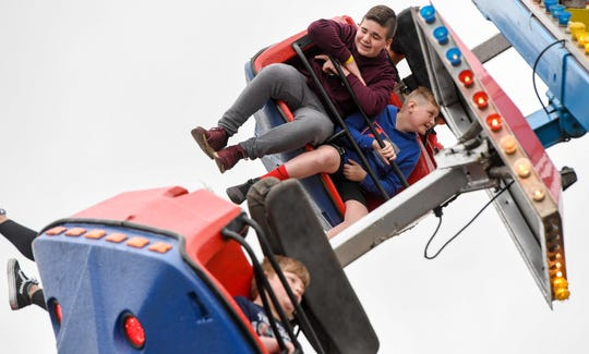 Festival goers ride the Superman at the 32nd annual Breakfast Lions Club Tri-Fest in downtown Henderson Saturday, April 27, 2019.