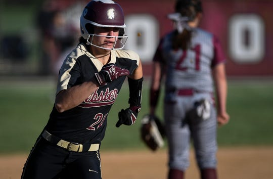 Webster County's Karlie Keeney (21) heads toward home plate in the first inning as district rivals the Webster County Lady Trojans play the Henderson County Lady Colonels at Henderson's North Field Friday, April 26, 2019.