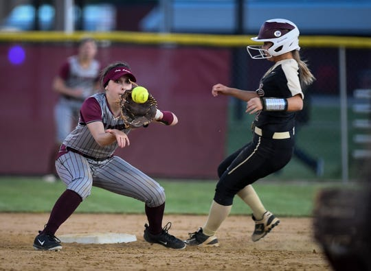Webster County's Rylee Warford (22) misses the tag from Henderson County's Sophie Margelot (4) as district rivals the Webster County Lady Trojans play the Henderson County Lady Colonels at Henderson's North Field Friday, April 26, 2019.