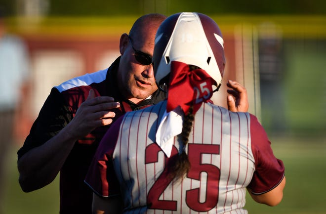 Henderson County head coach Shannon Troutman talks with Henderson County's Chiara Suggs (25) before a at bat as district rivals the Webster County Lady Trojans play the Henderson County Lady Colonels at Henderson's North Field Friday, April 26, 2019.