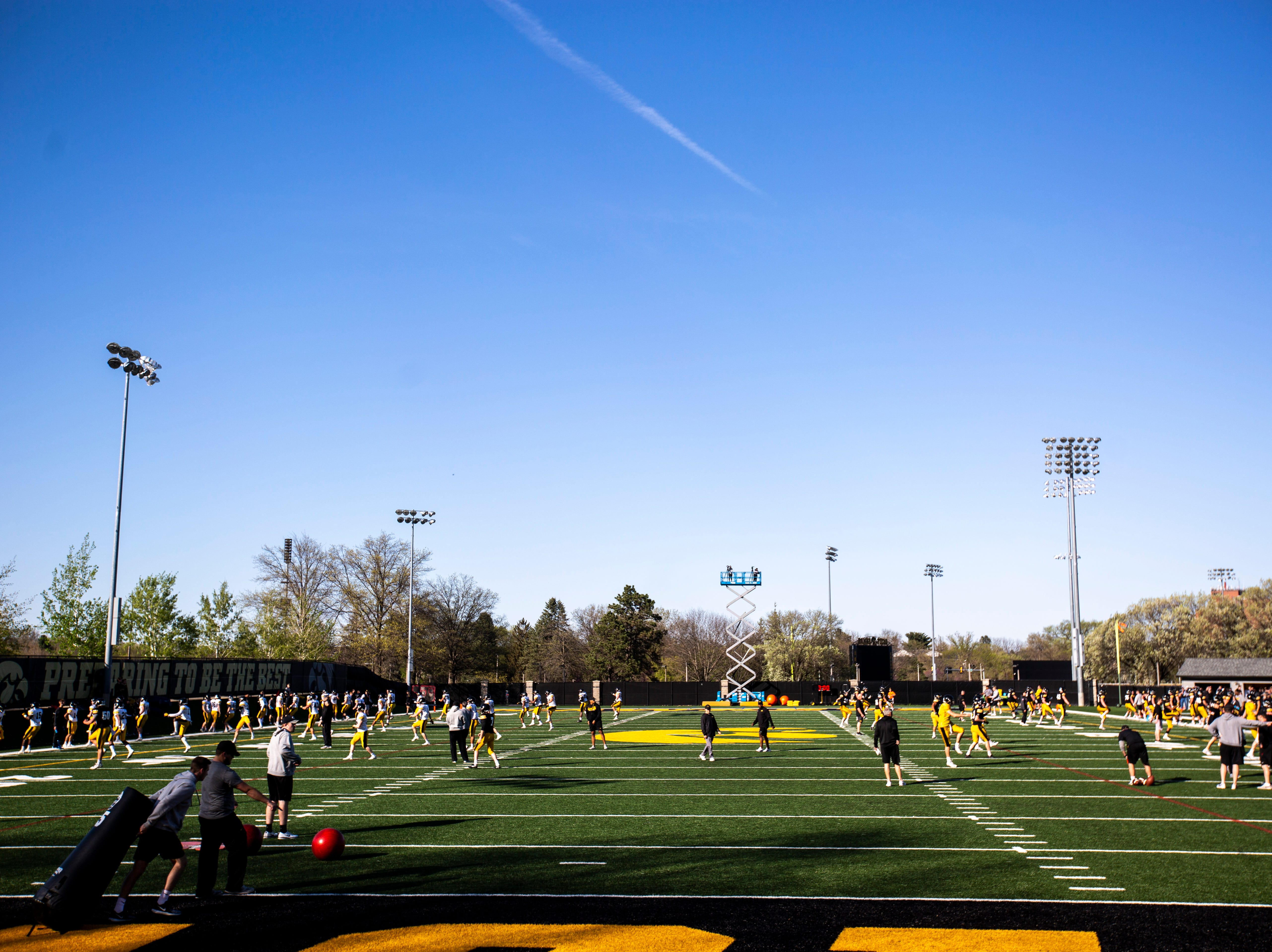 Iowa Hawkeyes get ready during the final spring football practice, Friday, April 26, 2019, at the University of Iowa outdoor practice facility in Iowa City, Iowa.