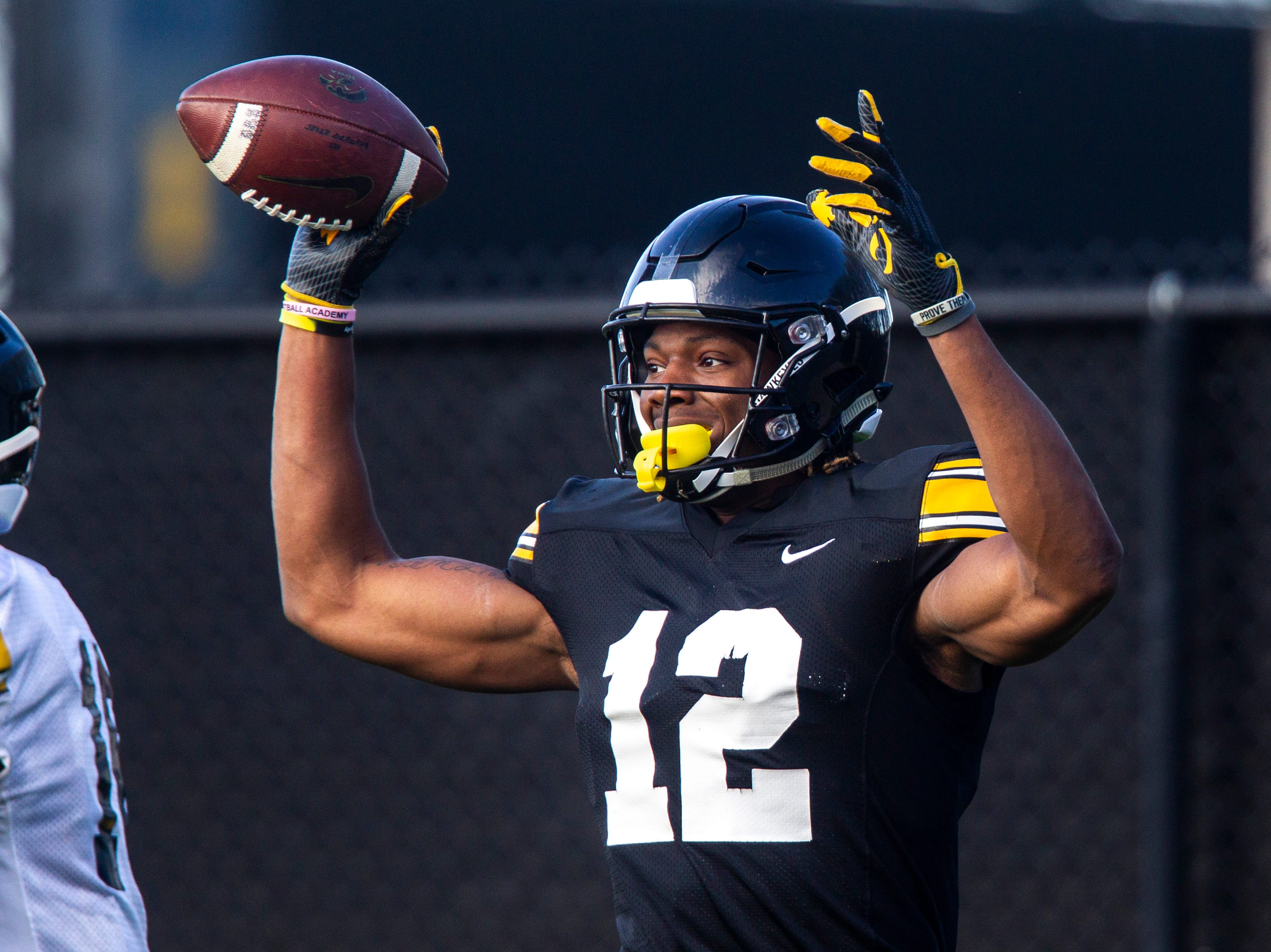 Iowa wide receiver Brandon Smith (12) celebrates after catching a touchdown pass during the final spring football practice, Friday, April 26, 2019, at the University of Iowa outdoor practice facility in Iowa City, Iowa.