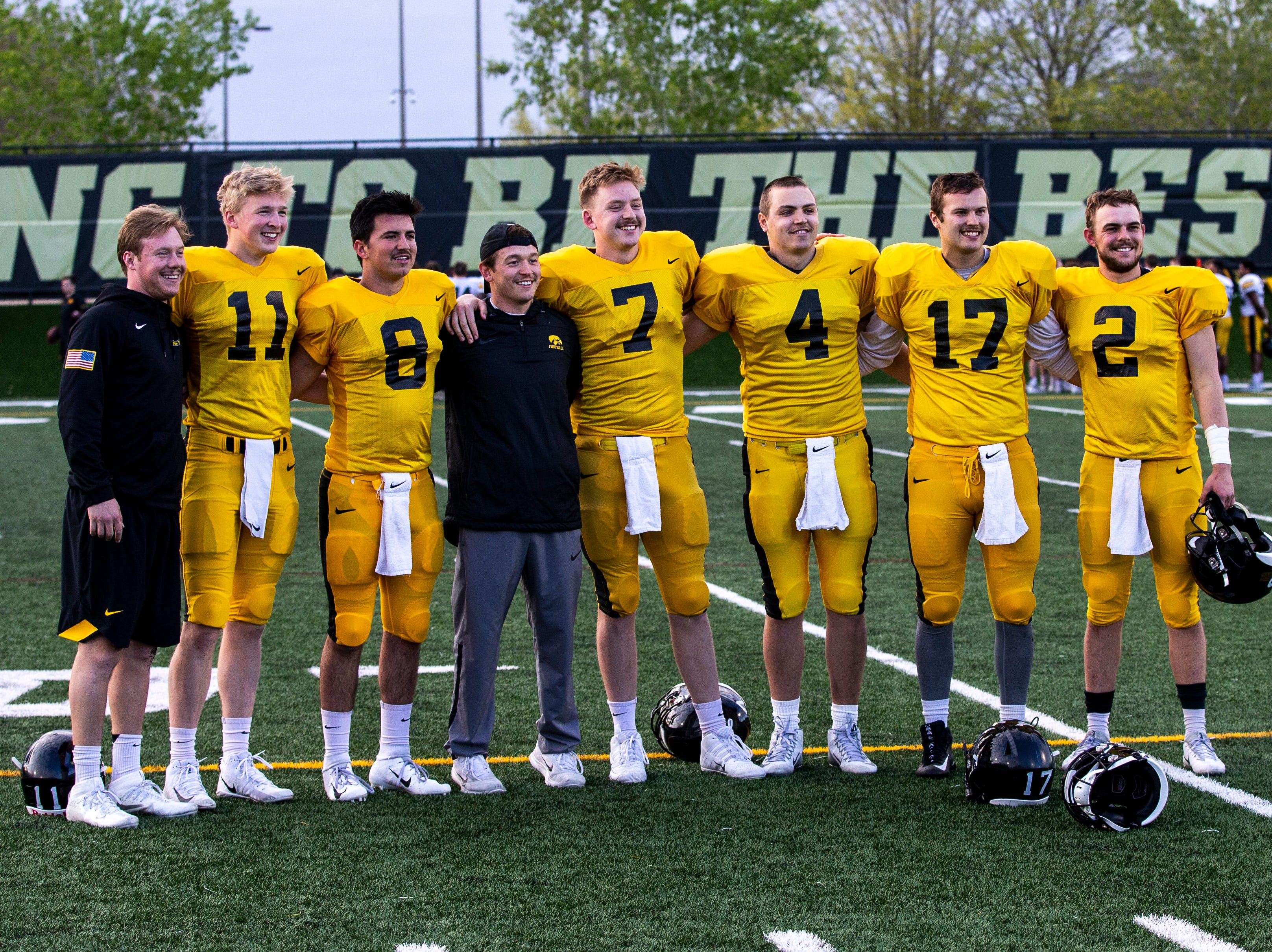 Iowa quarterbacks pose for a photo after the final spring football practice, Friday, April 26, 2019, at the University of Iowa outdoor practice facility in Iowa City, Iowa.