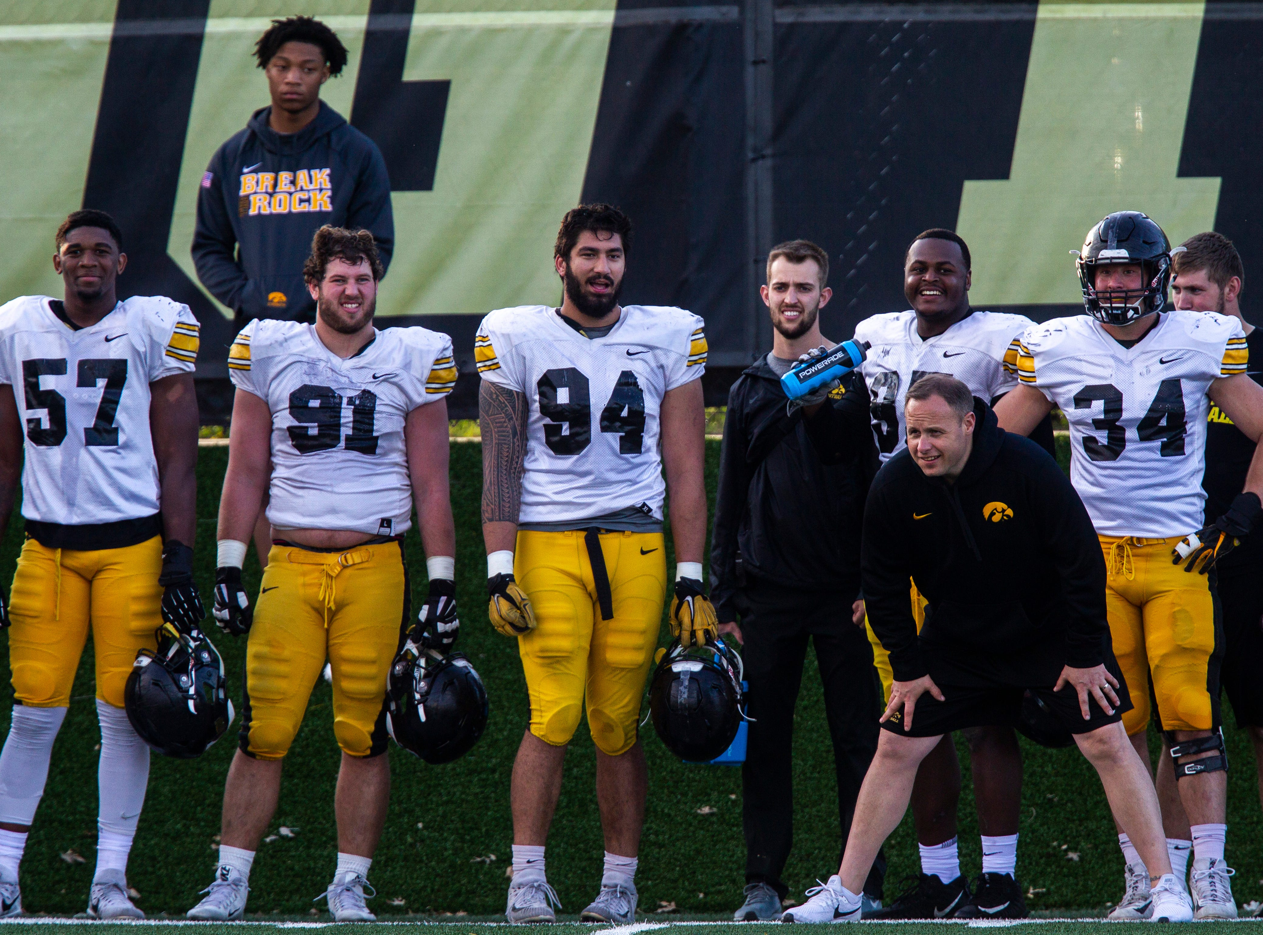 Iowa's Chauncey Golston, from left, Brady Reiff, A.J. Epenesa, Cedrick Lattimore and Kristian Welch stand on the sideline behind linebackers coach Seth Wallace during the final spring football practice, Friday, April 26, 2019, at the University of Iowa outdoor practice facility in Iowa City, Iowa.