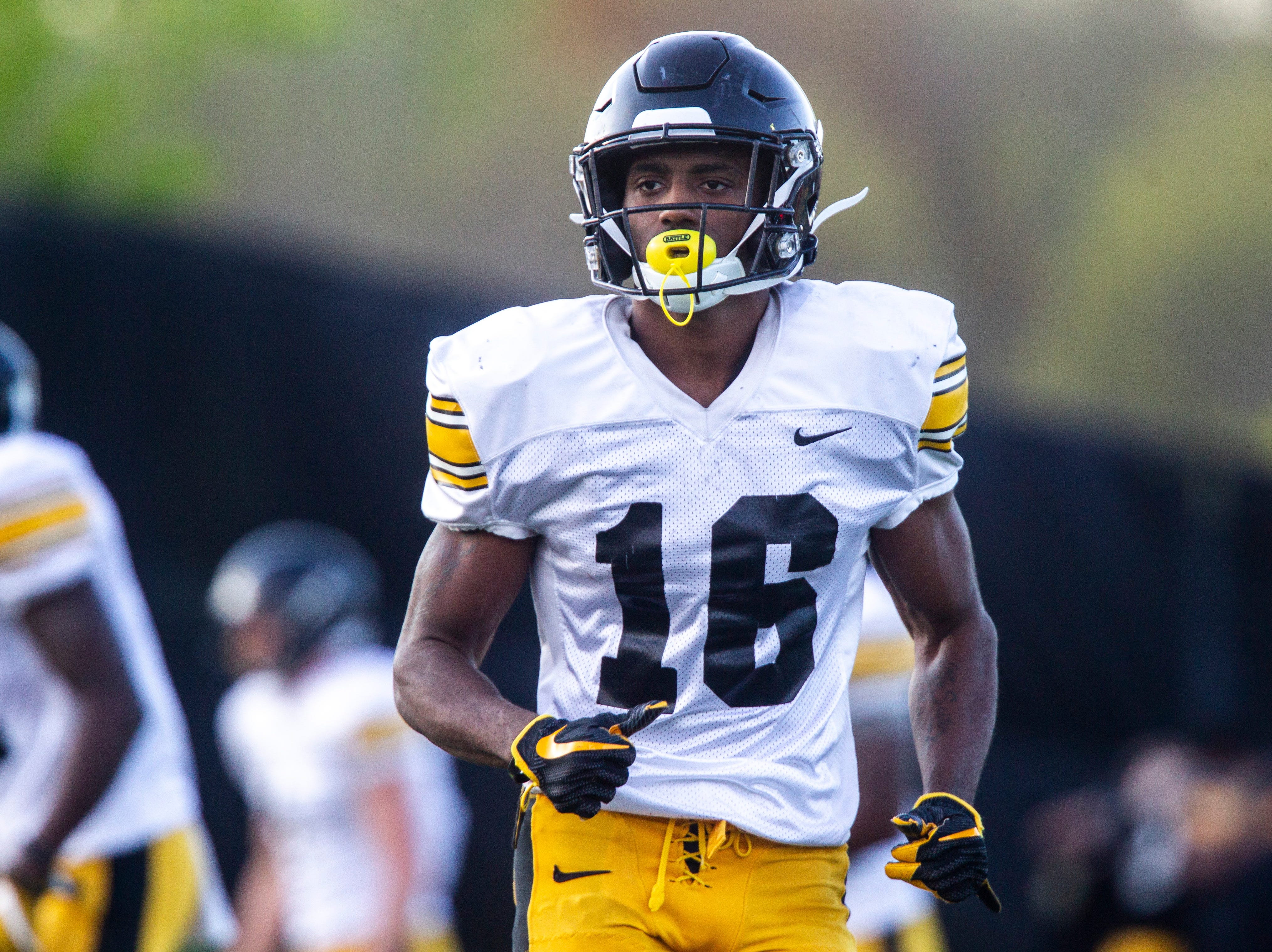 Iowa defensive back Terry Roberts (16) runs onto the field during the final spring football practice, Friday, April 26, 2019, at the University of Iowa outdoor practice facility in Iowa City, Iowa.
