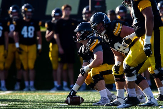 Iowa center Tyler Linderbaum (65) gets ready to snap the ball during the final spring football practice, Friday, April 26, 2019, at the University of Iowa outdoor practice facility in Iowa City, Iowa.