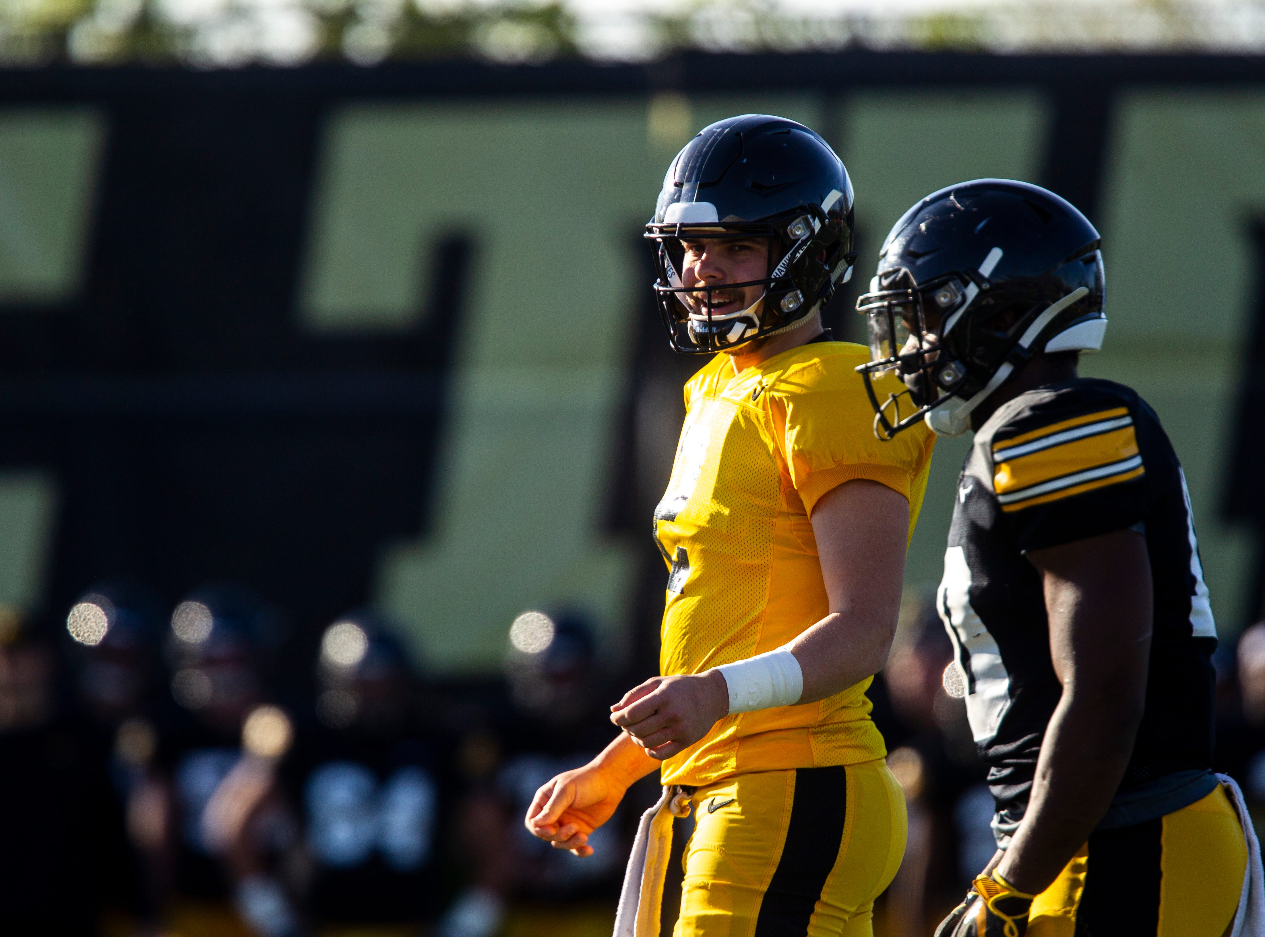 Iowa quarterback Peyton Mansell (2) lines up with Mekhi Sargent during the final spring football practice, Friday, April 26, 2019, at the University of Iowa outdoor practice facility in Iowa City, Iowa.