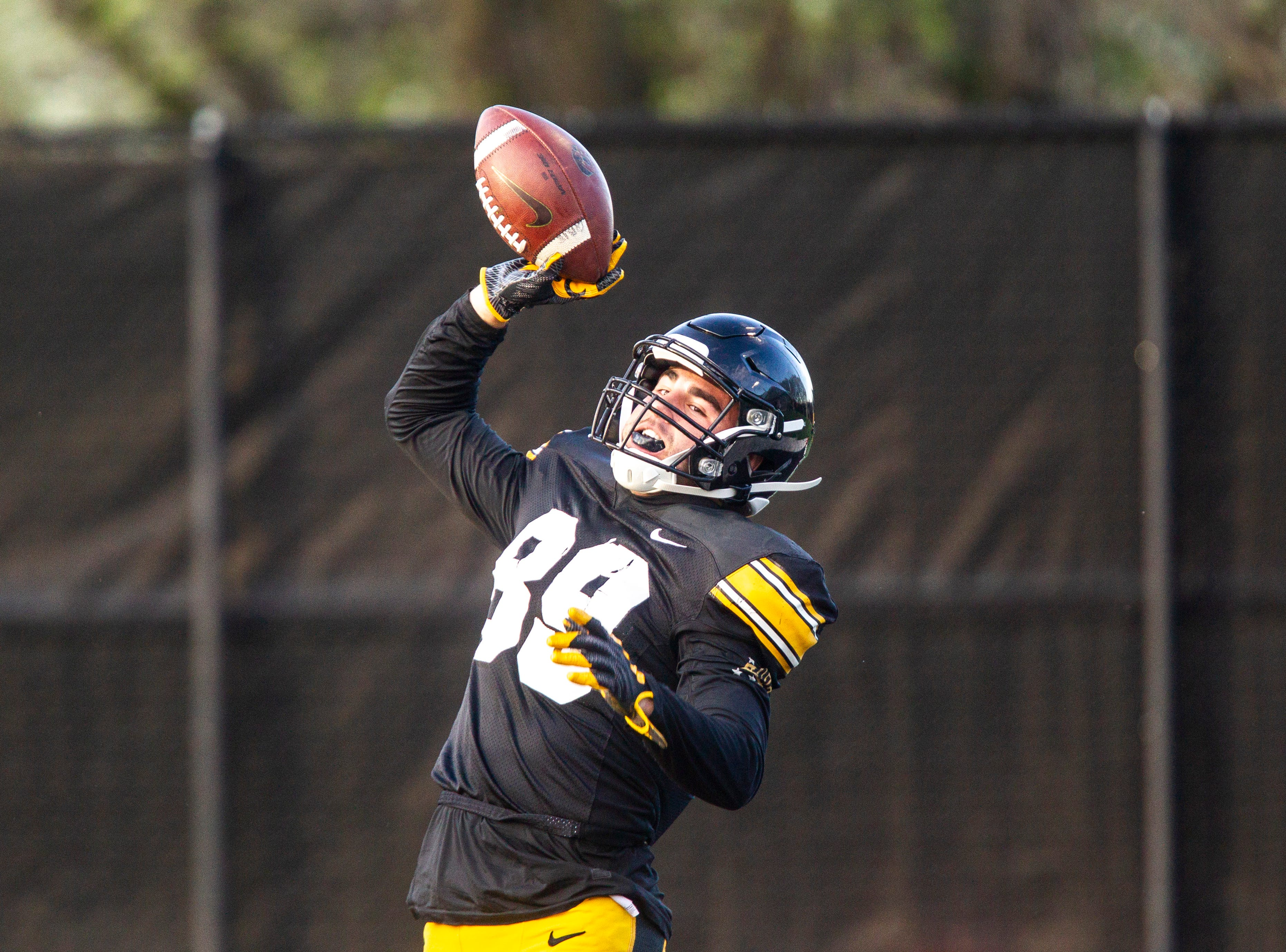 Iowa wide receiver Nico Ragaini (89) celebrates in the end zone after catching a pass on the final play during the final spring football practice, Friday, April 26, 2019, at the University of Iowa outdoor practice facility in Iowa City, Iowa.