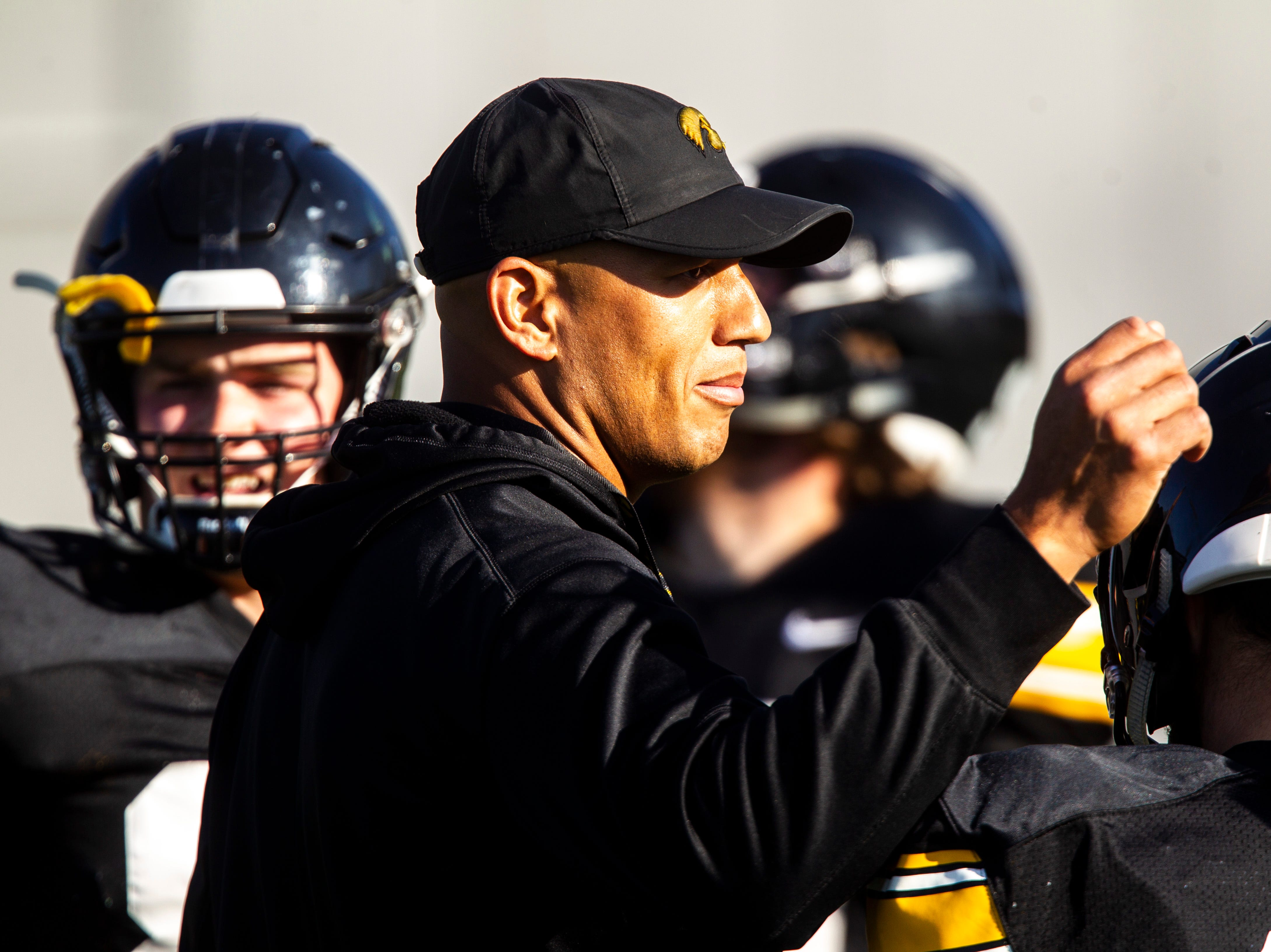 Iowa special teams coordinator LeVar Woods huddles up with players during the final spring football practice, Friday, April 26, 2019, at the University of Iowa outdoor practice facility in Iowa City, Iowa.
