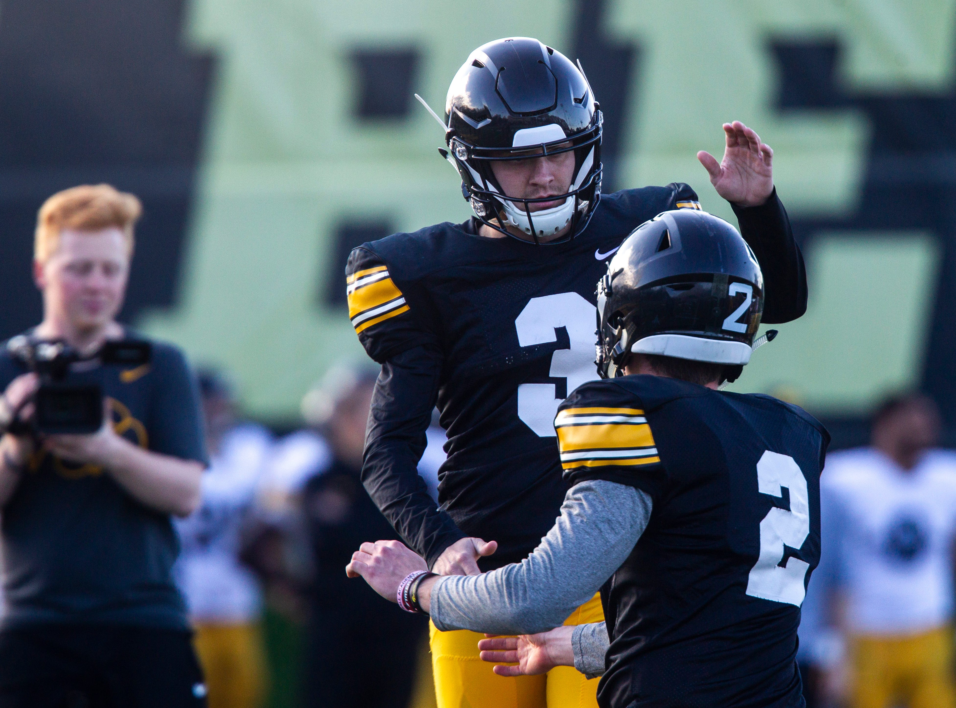 Iowa placekicker Keith Duncan (3) celebrates with holder Ryan Gersonde (2) after a made field goal during the final spring football practice, Friday, April 26, 2019, at the University of Iowa outdoor practice facility in Iowa City, Iowa.