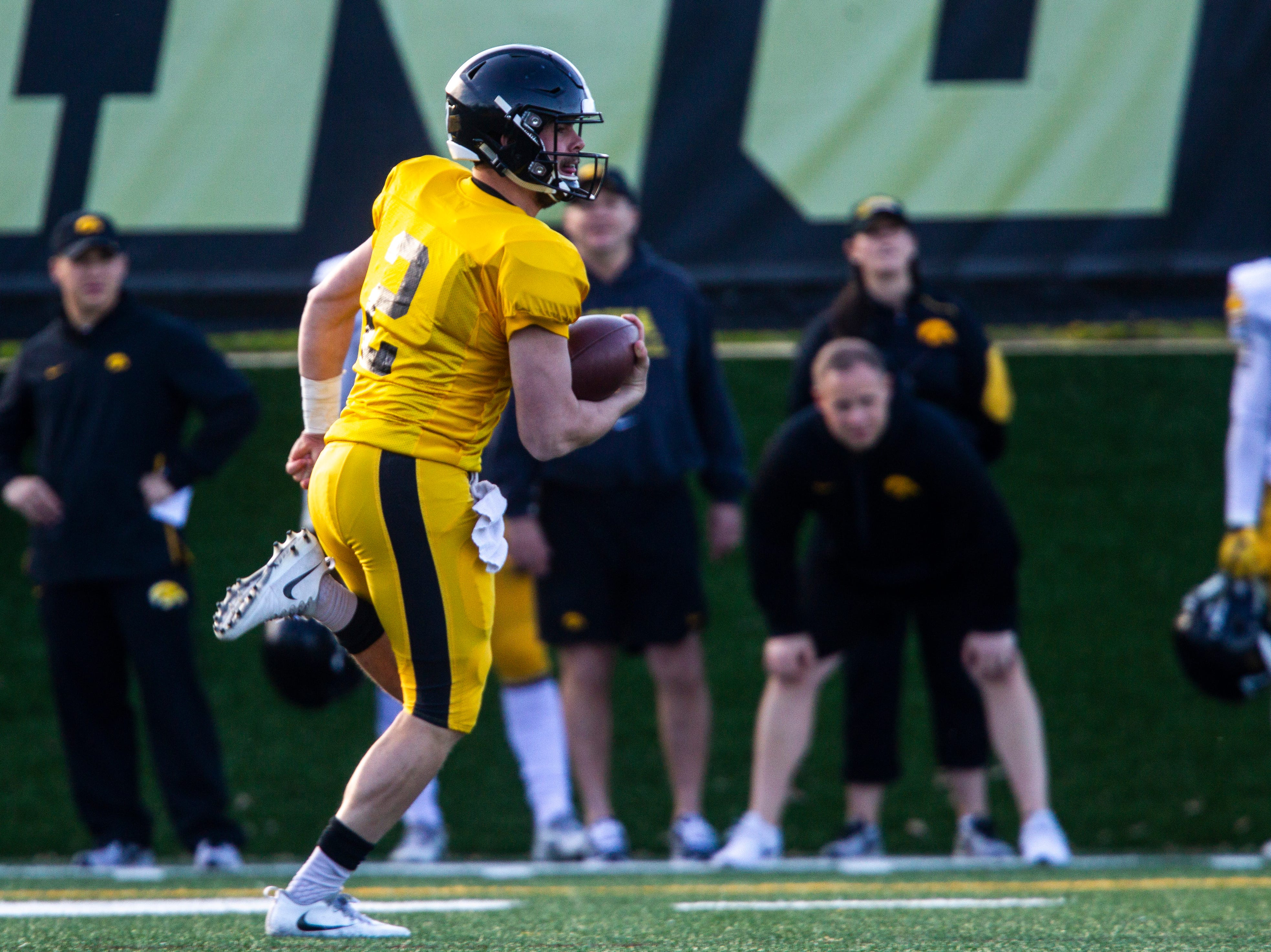 Iowa quarterback Peyton Mansell (2) rushes during the final spring football practice, Friday, April 26, 2019, at the University of Iowa outdoor practice facility in Iowa City, Iowa.