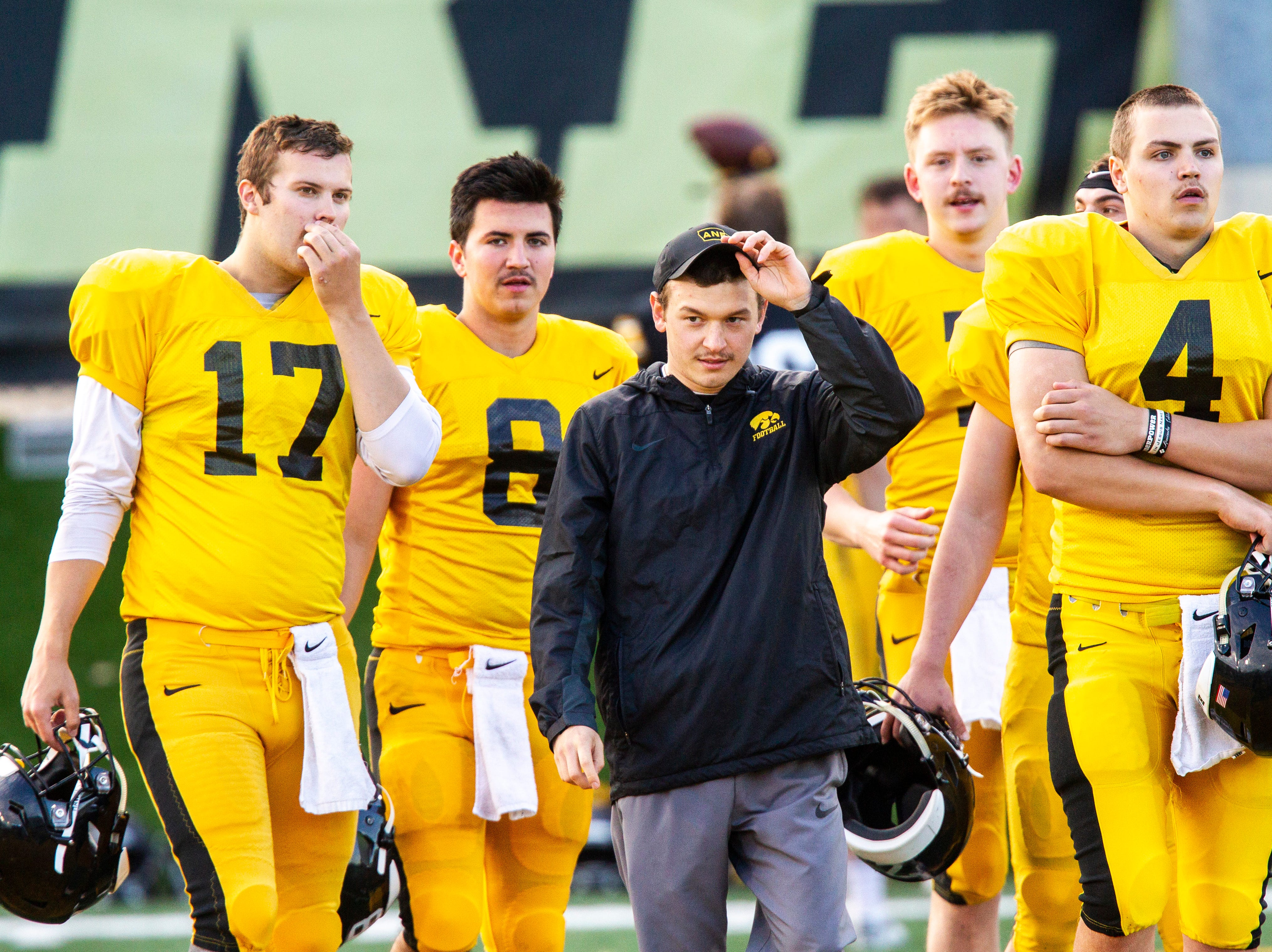 Iowa quarterbacks, from left, Ryan Schmidt (17) Alex Padilla (8), Spencer Petras and Nate Stanley (4) sport mustaches during the final spring football practice, Friday, April 26, 2019, at the University of Iowa outdoor practice facility in Iowa City, Iowa.