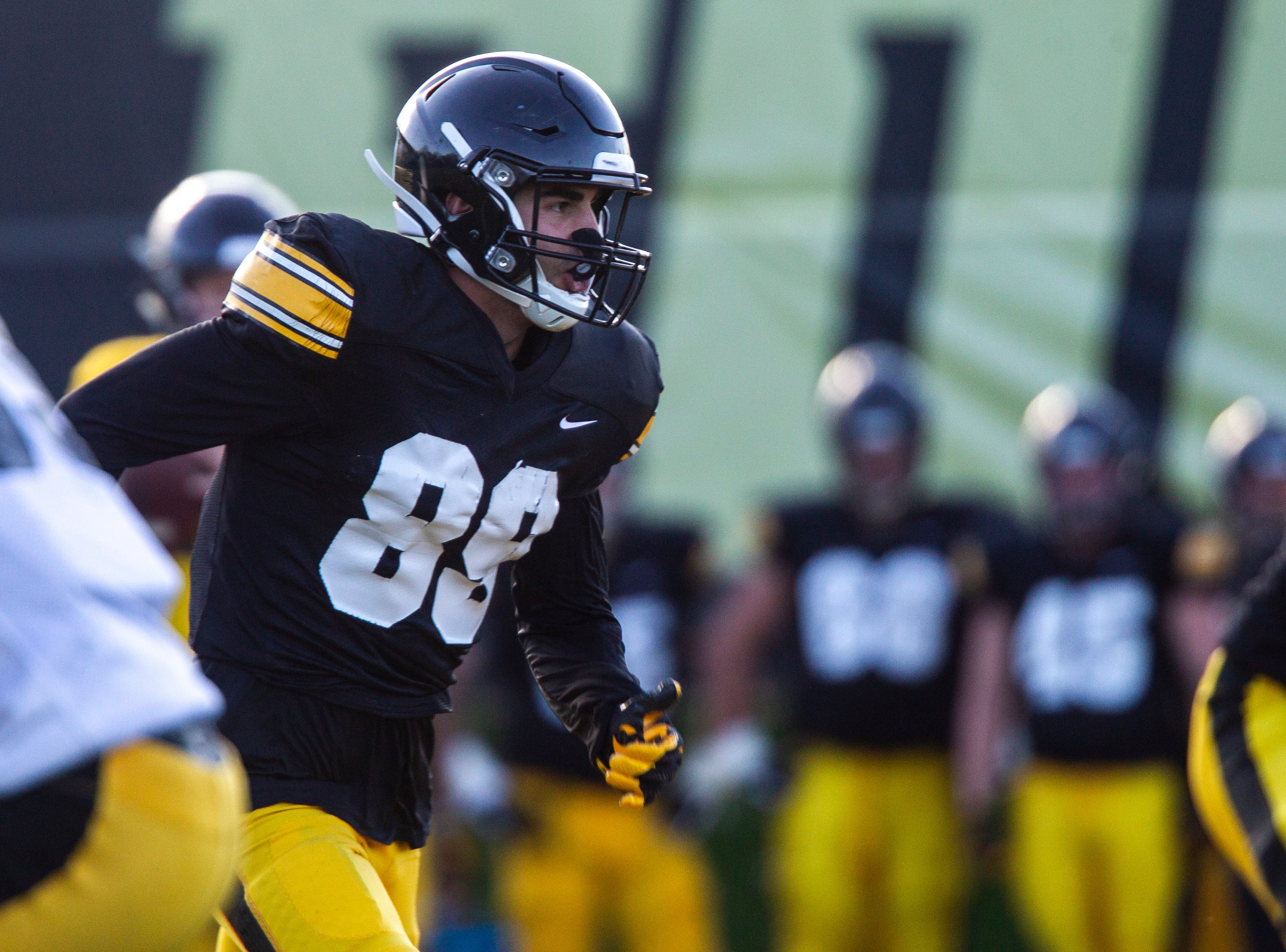 Iowa wide receiver Nico Ragaini (89) runs a route during the final spring football practice, Friday, April 26, 2019, at the University of Iowa outdoor practice facility in Iowa City, Iowa.