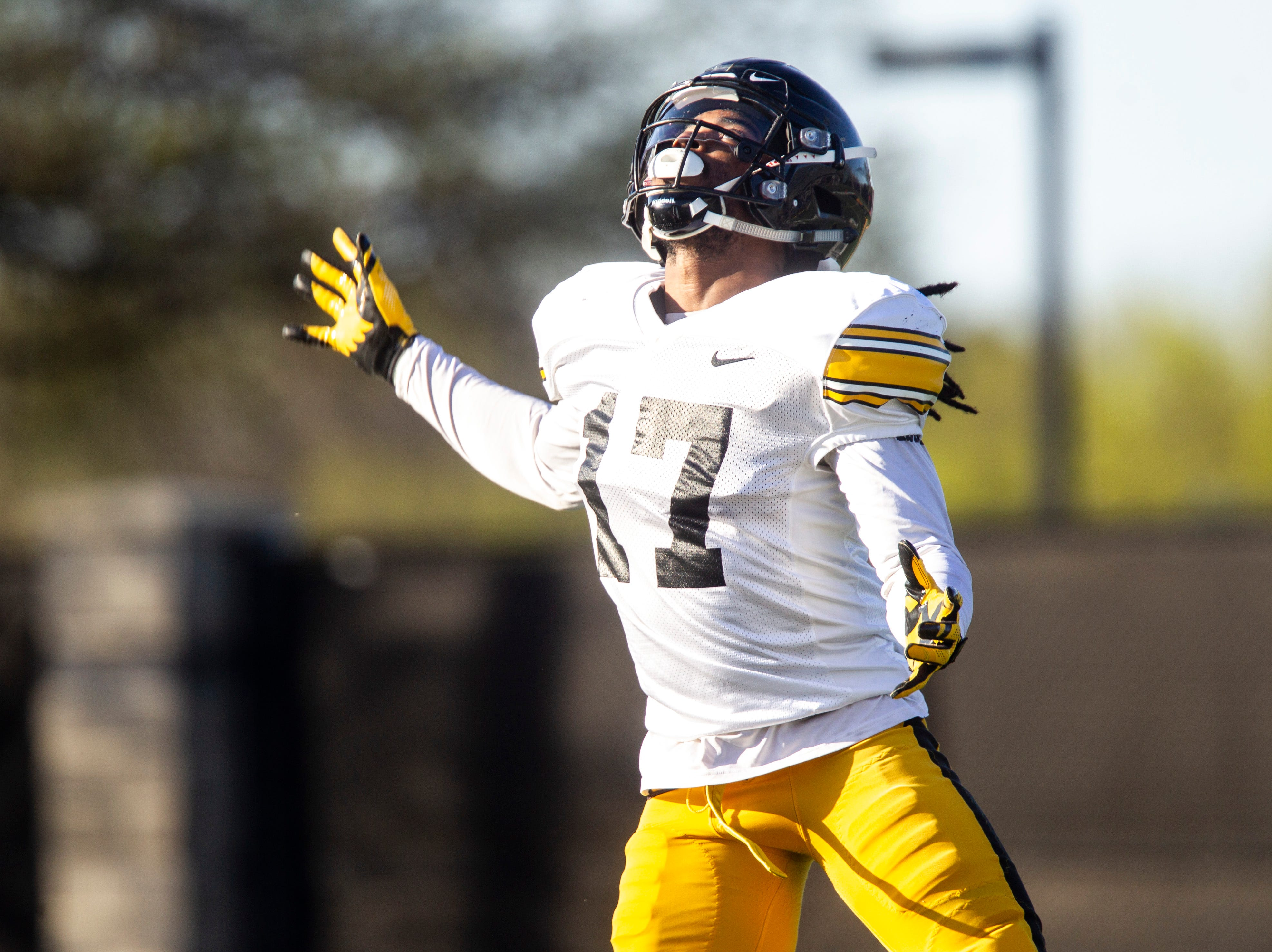 Iowa defensive back Devonte Young (17) tries to field a punt during the final spring football practice, Friday, April 26, 2019, at the University of Iowa outdoor practice facility in Iowa City, Iowa.