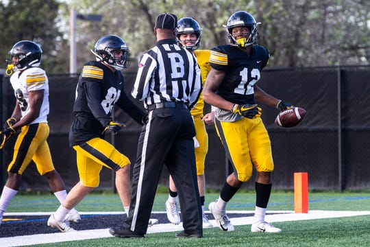Junior Brandon Smith, right, and freshman Nico Ragaini, left, are both listed as starting wide receivers along with Ihmir Smith-Marsette on Iowa's 2019 preseason depth chart released Thursday.