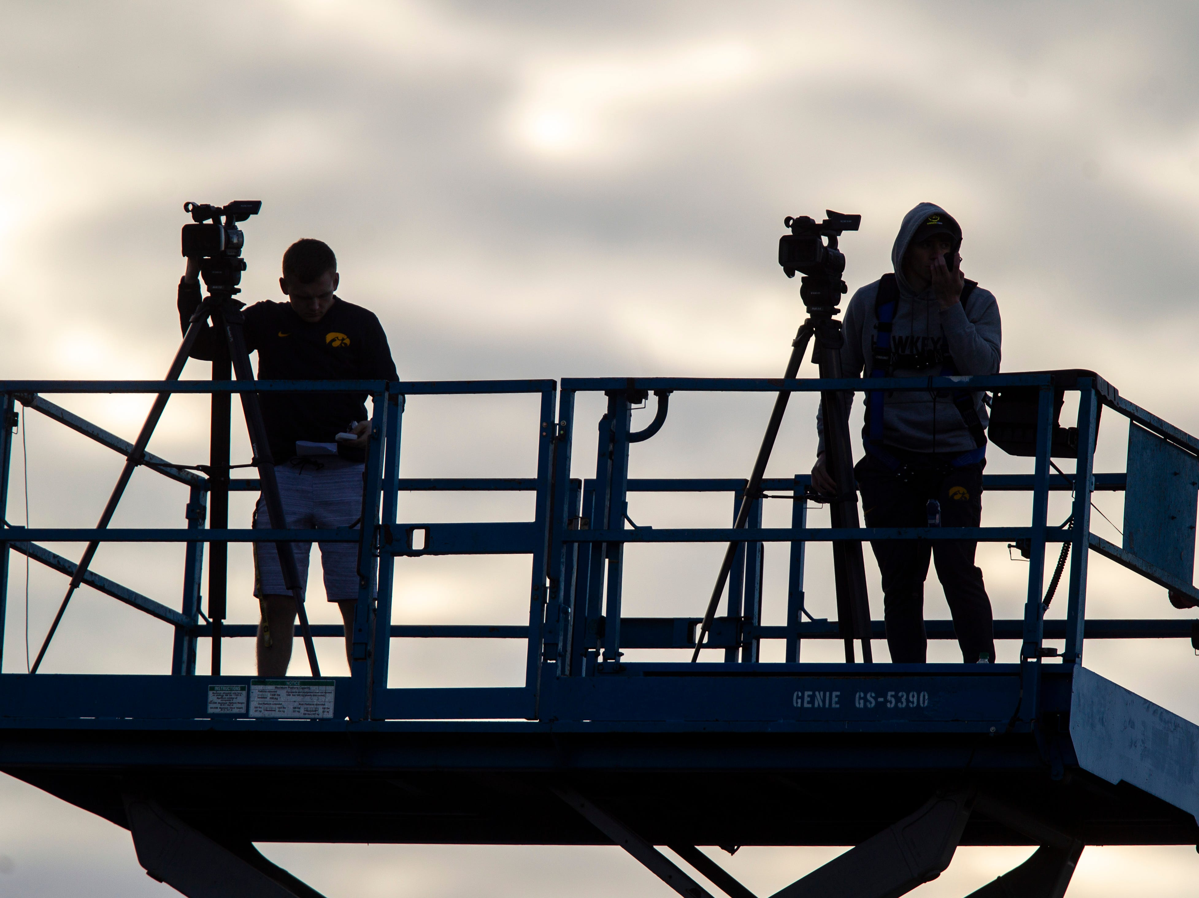 Iowa staff film play from a scissor lift during the final spring football practice, Friday, April 26, 2019, at the University of Iowa outdoor practice facility in Iowa City, Iowa.
