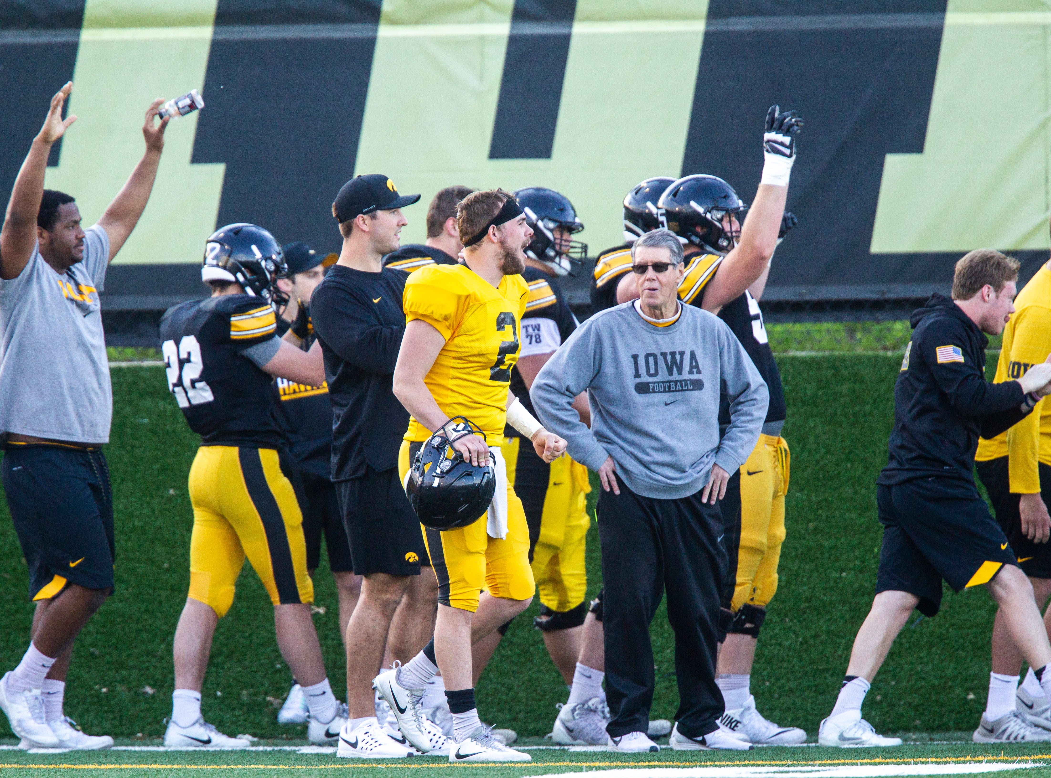 Iowa offensive players celebrate following a play during the final spring football practice, Friday, April 26, 2019, at the University of Iowa outdoor practice facility in Iowa City, Iowa.