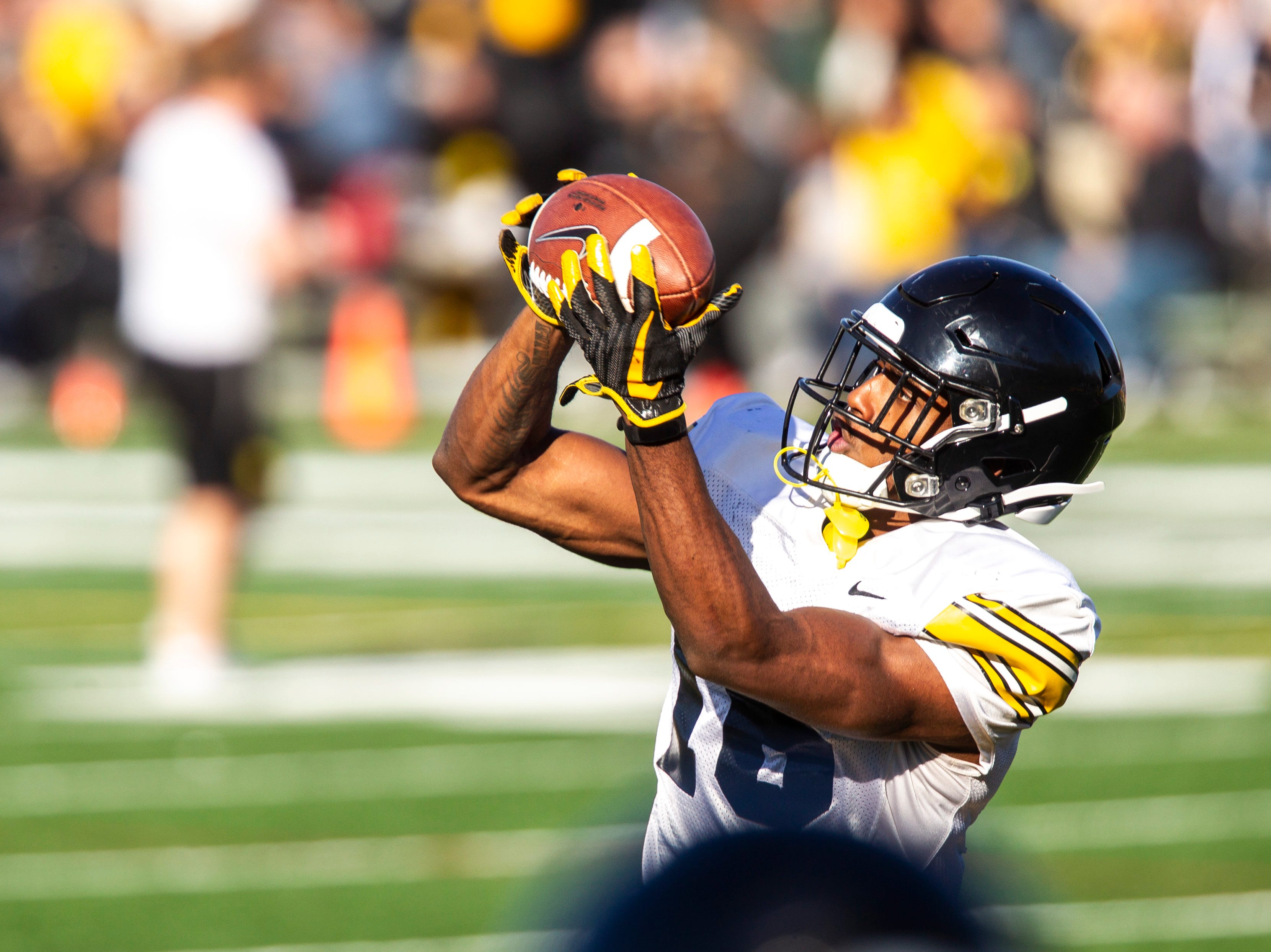 Iowa defensive back Terry Roberts (16) catches a pass while running a drill during the final spring football practice, Friday, April 26, 2019, at the University of Iowa outdoor practice facility in Iowa City, Iowa.