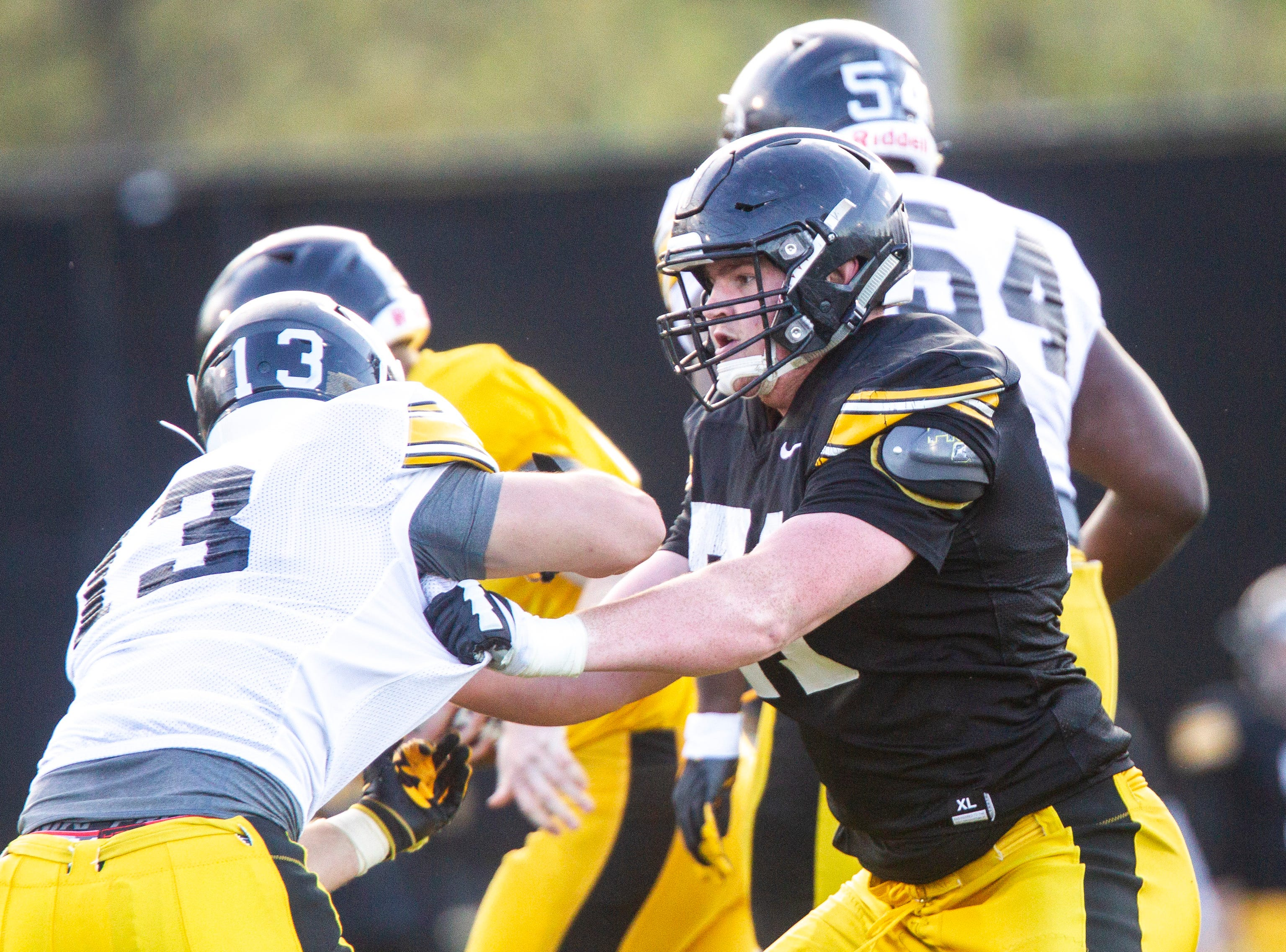Iowa offensive lineman Mark Kallenberger (71) blocks during the final spring football practice, Friday, April 26, 2019, at the University of Iowa outdoor practice facility in Iowa City, Iowa.