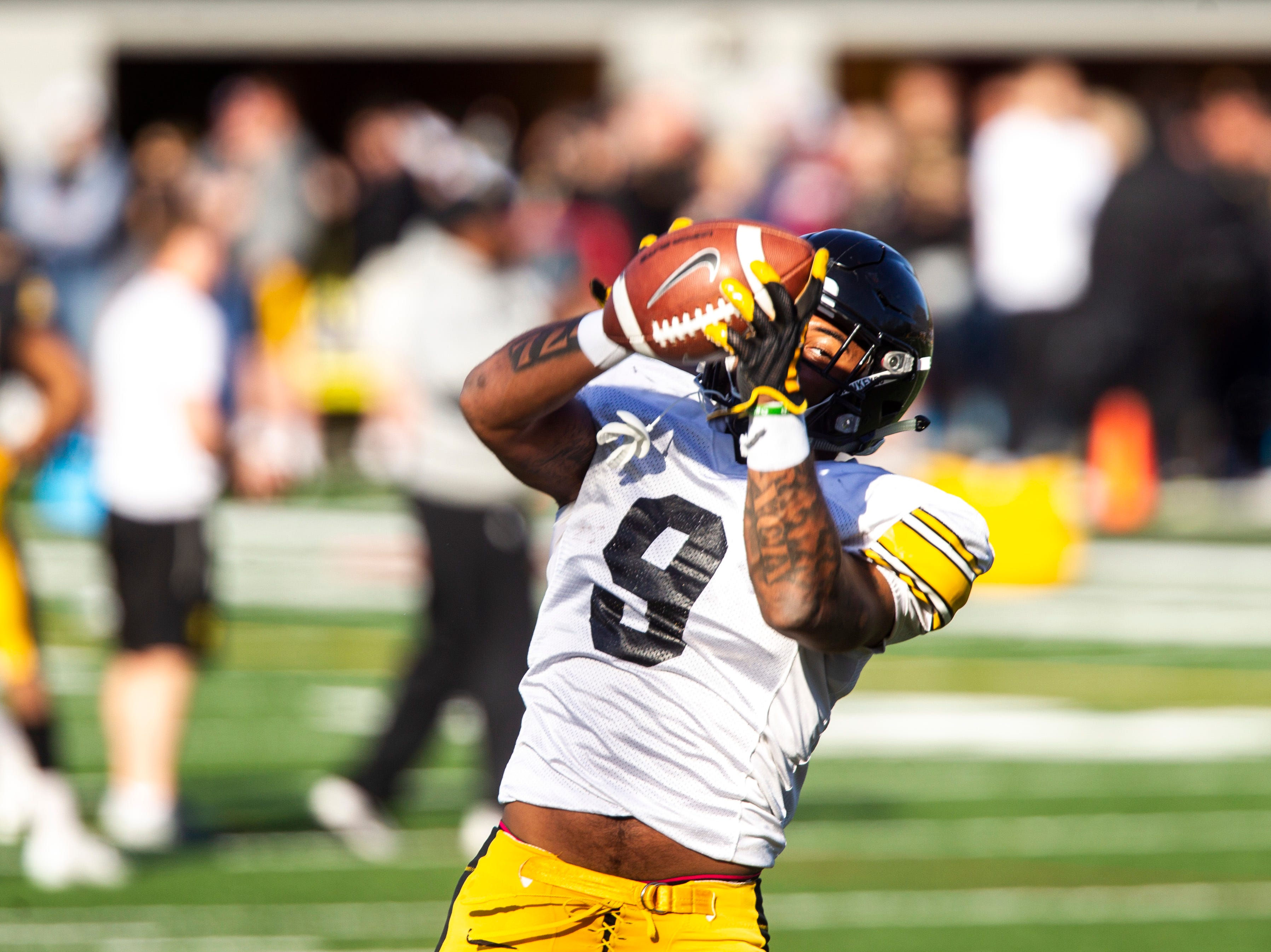 Iowa defensive back Geno Stone (9) catches a pass while running a drill during the final spring football practice, Friday, April 26, 2019, at the University of Iowa outdoor practice facility in Iowa City, Iowa.