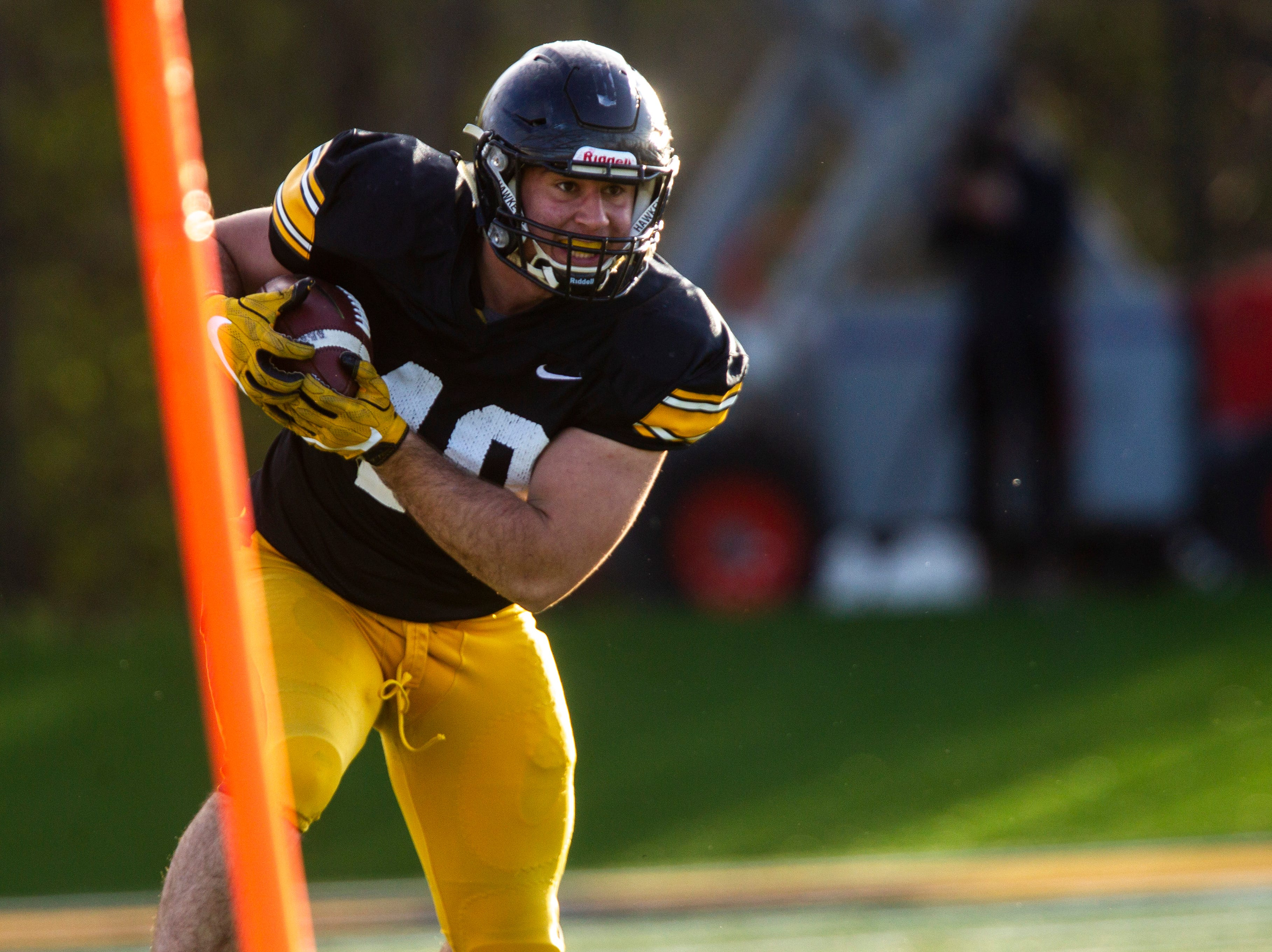 Iowa fullback Turner Pallissard (40) runs up the sideline during the final spring football practice, Friday, April 26, 2019, at the University of Iowa outdoor practice facility in Iowa City, Iowa.