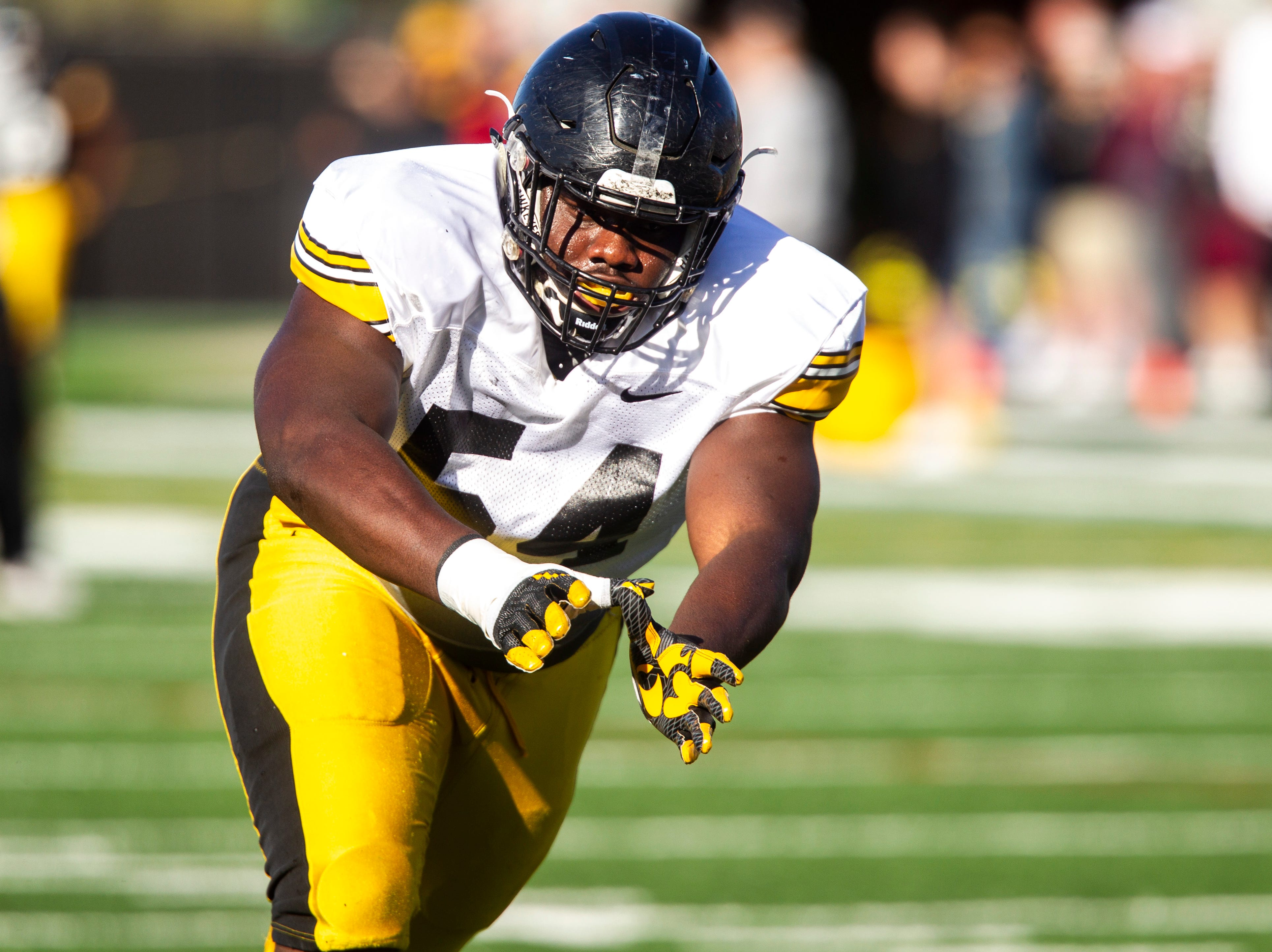 Iowa defensive tackle Daviyon Nixon runs a drill during the final spring football practice, Friday, April 26, 2019, at the University of Iowa outdoor practice facility in Iowa City, Iowa.