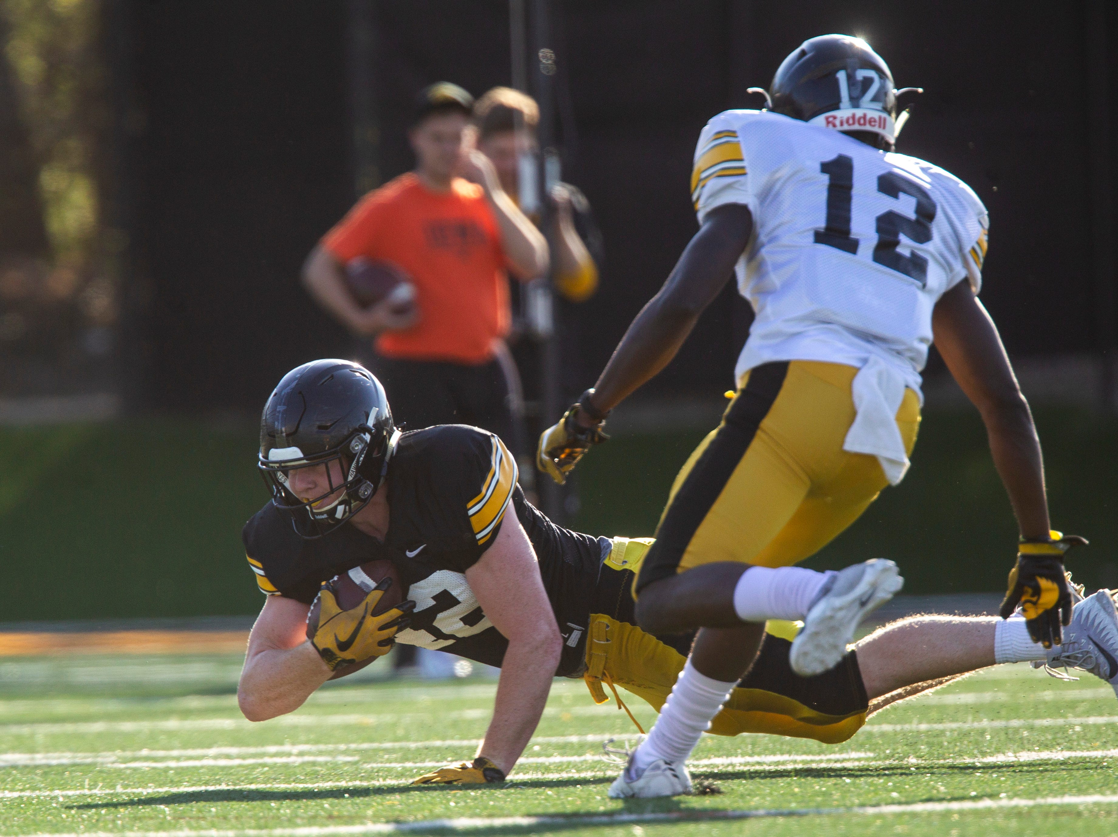 Iowa tight end Shaun Beyer (42) makes a diving catch during the final spring football practice, Friday, April 26, 2019, at the University of Iowa outdoor practice facility in Iowa City, Iowa.