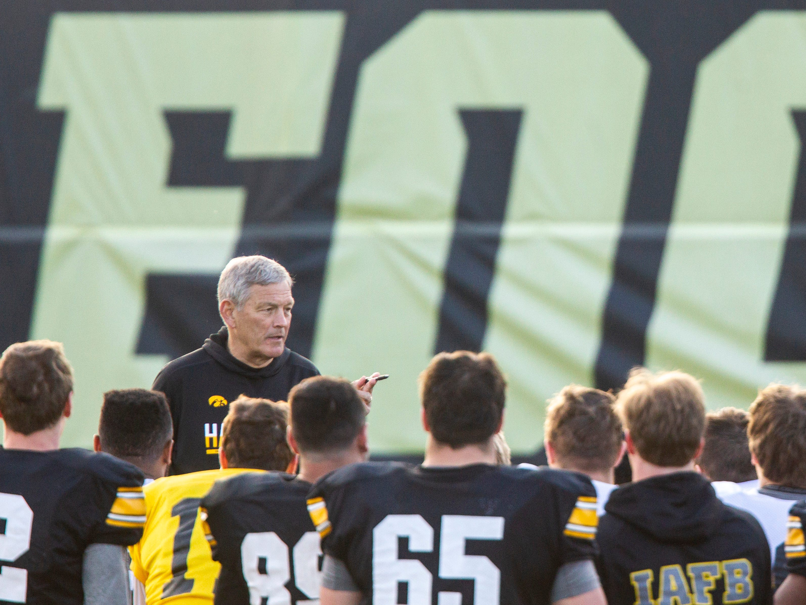 Iowa head coach Kirk Ferentz talks with players during the final spring football practice, Friday, April 26, 2019, at the University of Iowa outdoor practice facility in Iowa City, Iowa.