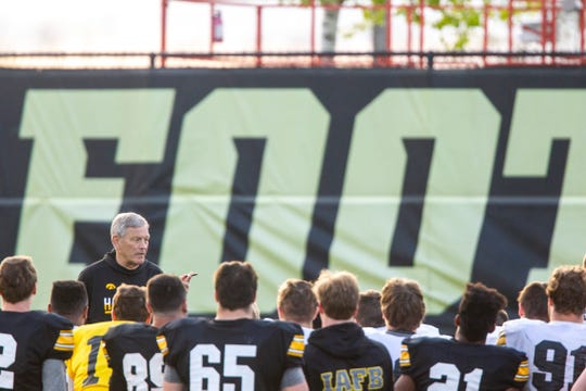 Kirk Ferentz addresses the Hawkeyes after their final spring practice Friday night.