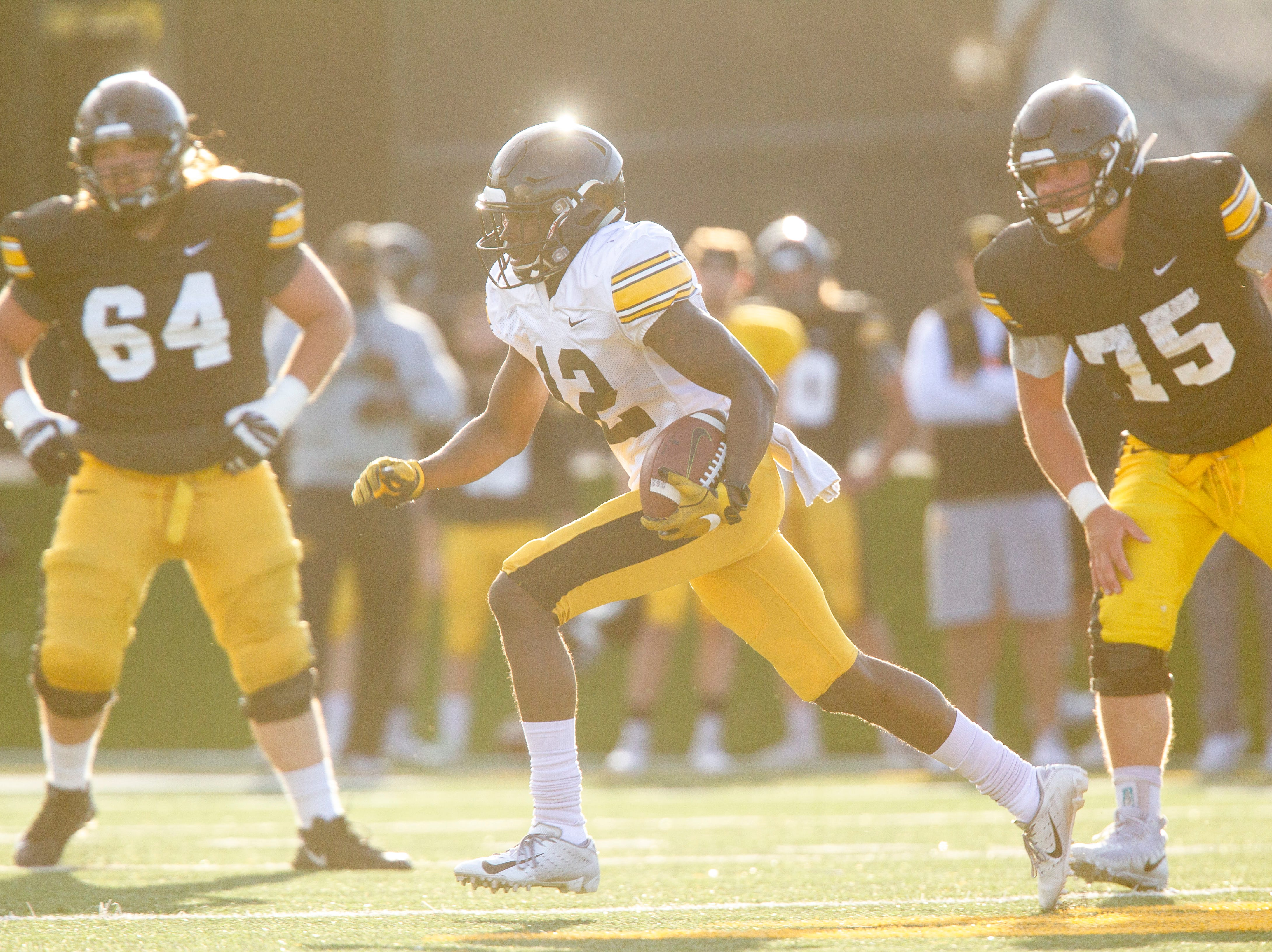 Iowa defensive back D.J. Johnson run a up field after getting an interception during the final spring football practice, Friday, April 26, 2019, at the University of Iowa outdoor practice facility in Iowa City, Iowa.