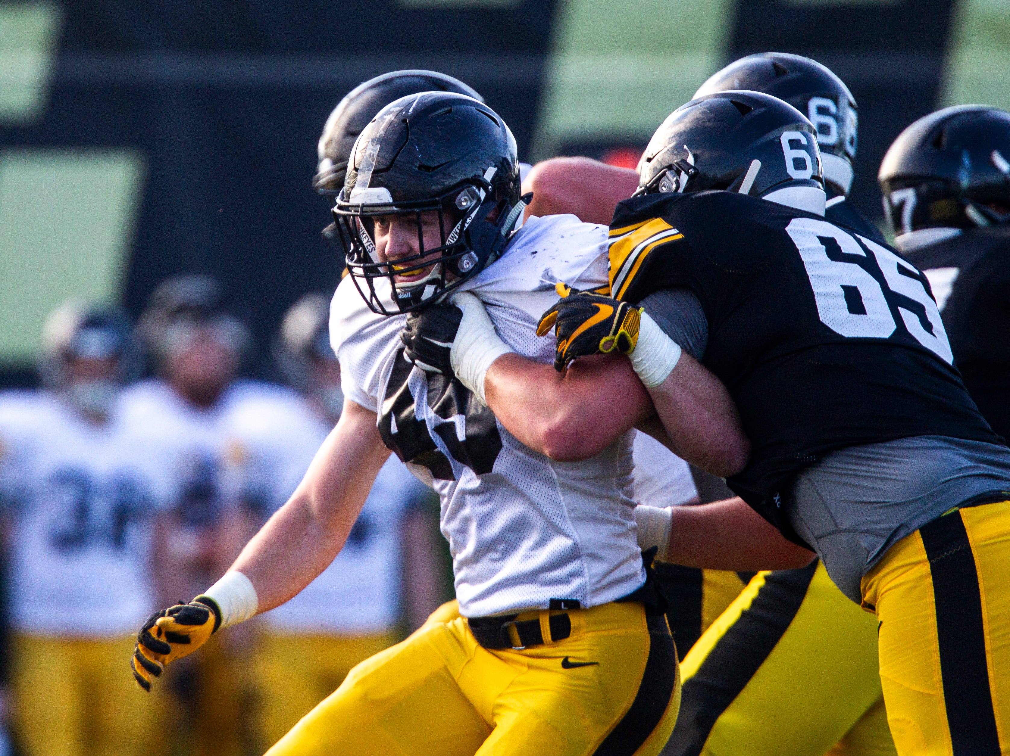 Iowa linebacker Nick Niemann (49) breaks past center Tyler Linderbaum during the final spring football practice, Friday, April 26, 2019, at the University of Iowa outdoor practice facility in Iowa City, Iowa.