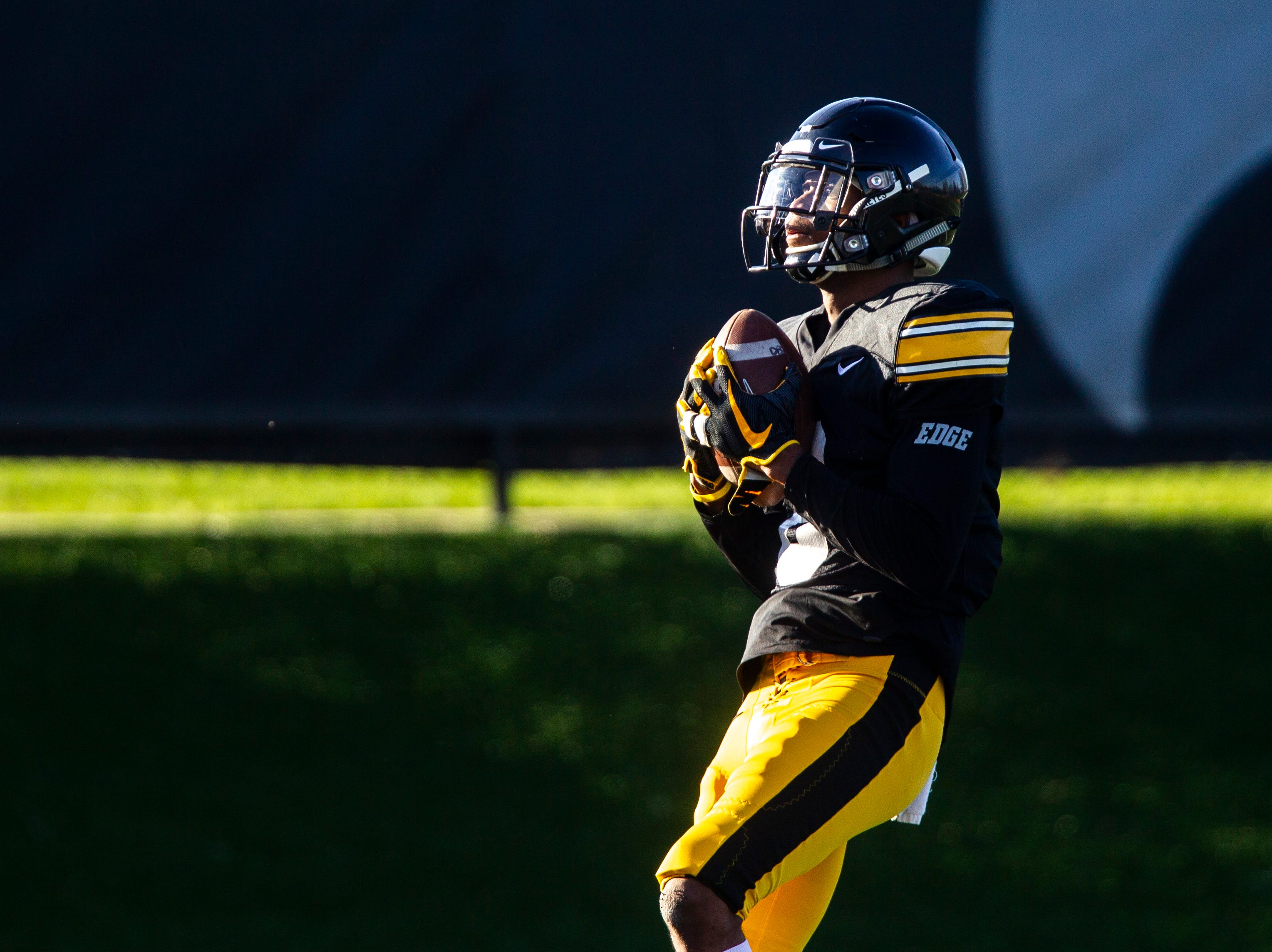 Iowa wide receiver Ihmir Smith-Marsette (6) catches a punt return during the final spring football practice, Friday, April 26, 2019, at the University of Iowa outdoor practice facility in Iowa City, Iowa.