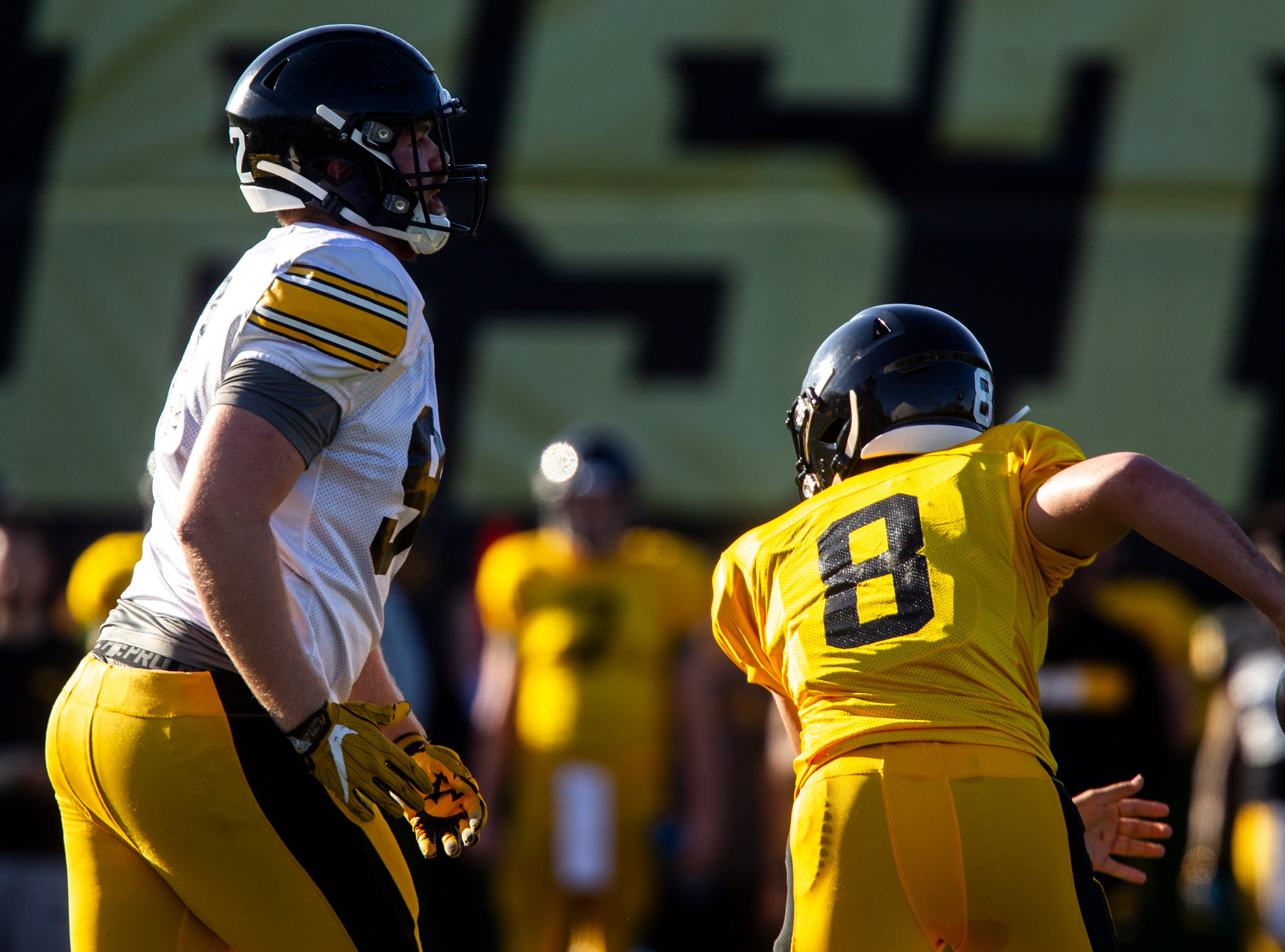 Iowa defensive lineman John Waggoner (92) breaks through the line towards quarterback Alex Padilla (8) during the final spring football practice, Friday, April 26, 2019, at the University of Iowa outdoor practice facility in Iowa City, Iowa.