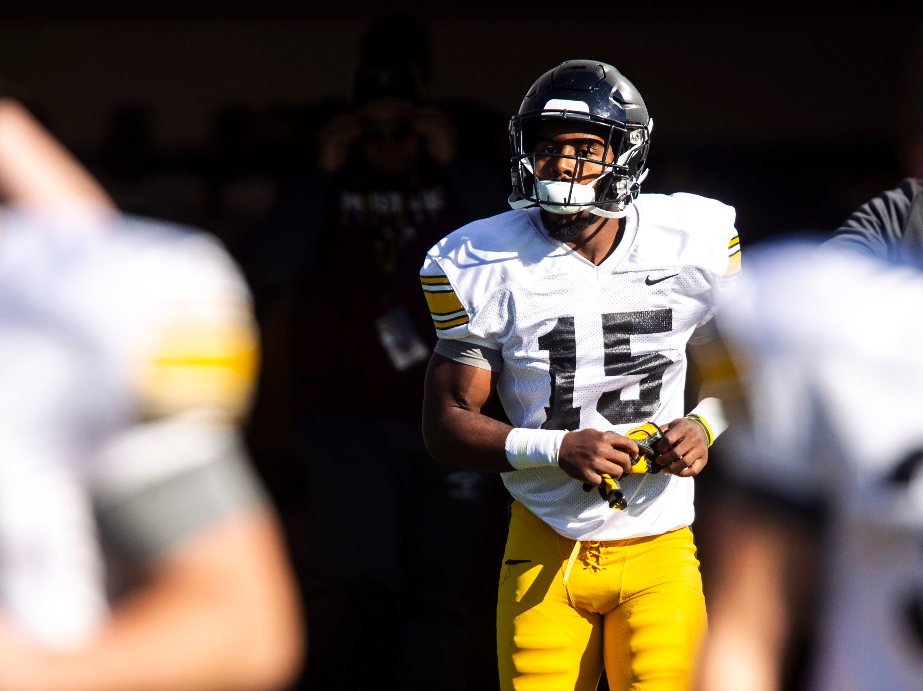 Iowa defensive back Dallas Craddieth (15) walks out to the field during the final spring football practice, Friday, April 26, 2019, at the University of Iowa outdoor practice facility in Iowa City, Iowa.