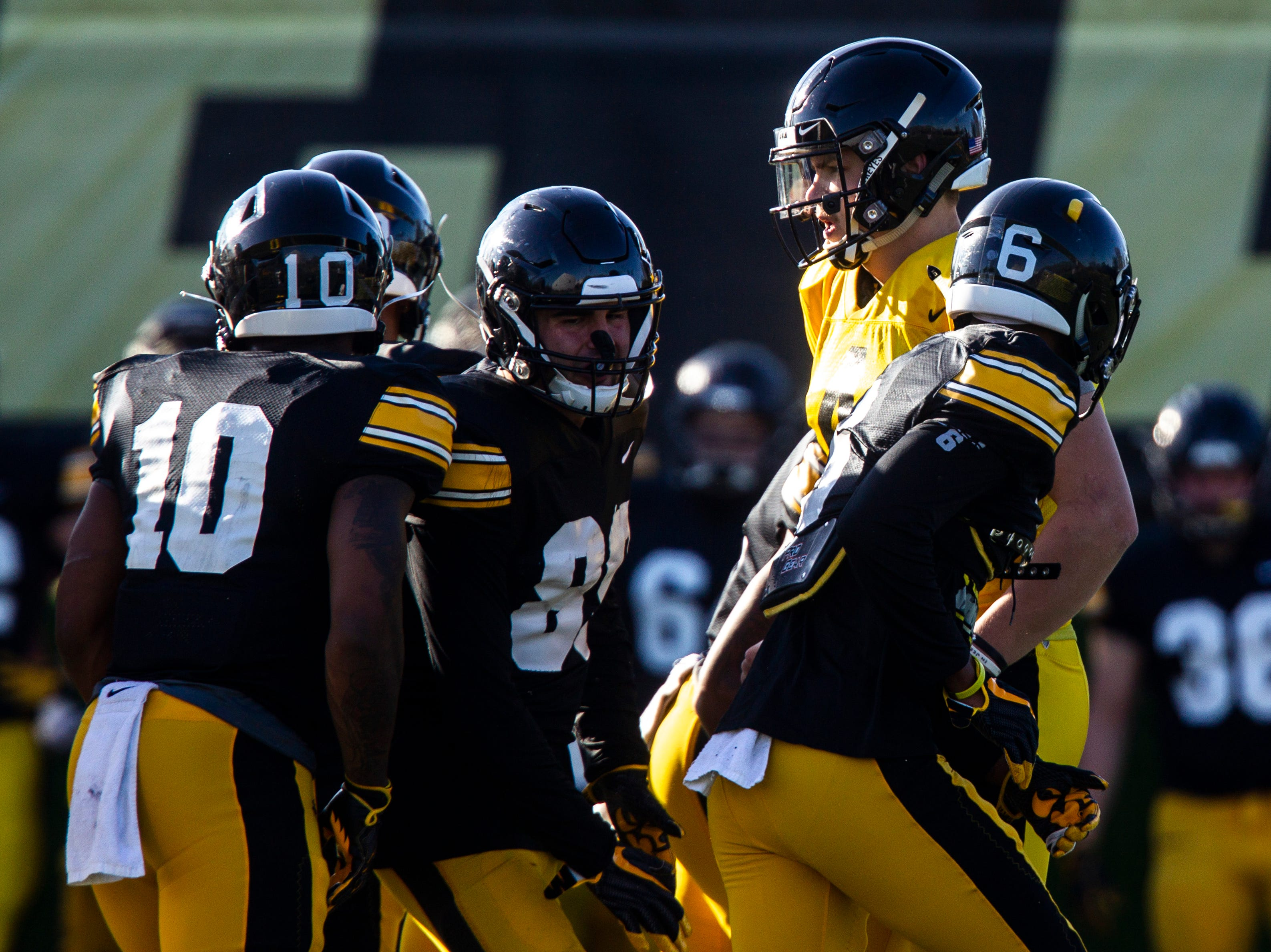 Iowa quarterback Nate Stanley calls a play in the huddle to teammates Mekhi Sargent (10) Nico Ragaini (89) and Ihmir Smith-Marstte (6) during the final spring football practice, Friday, April 26, 2019, at the University of Iowa outdoor practice facility in Iowa City, Iowa.
