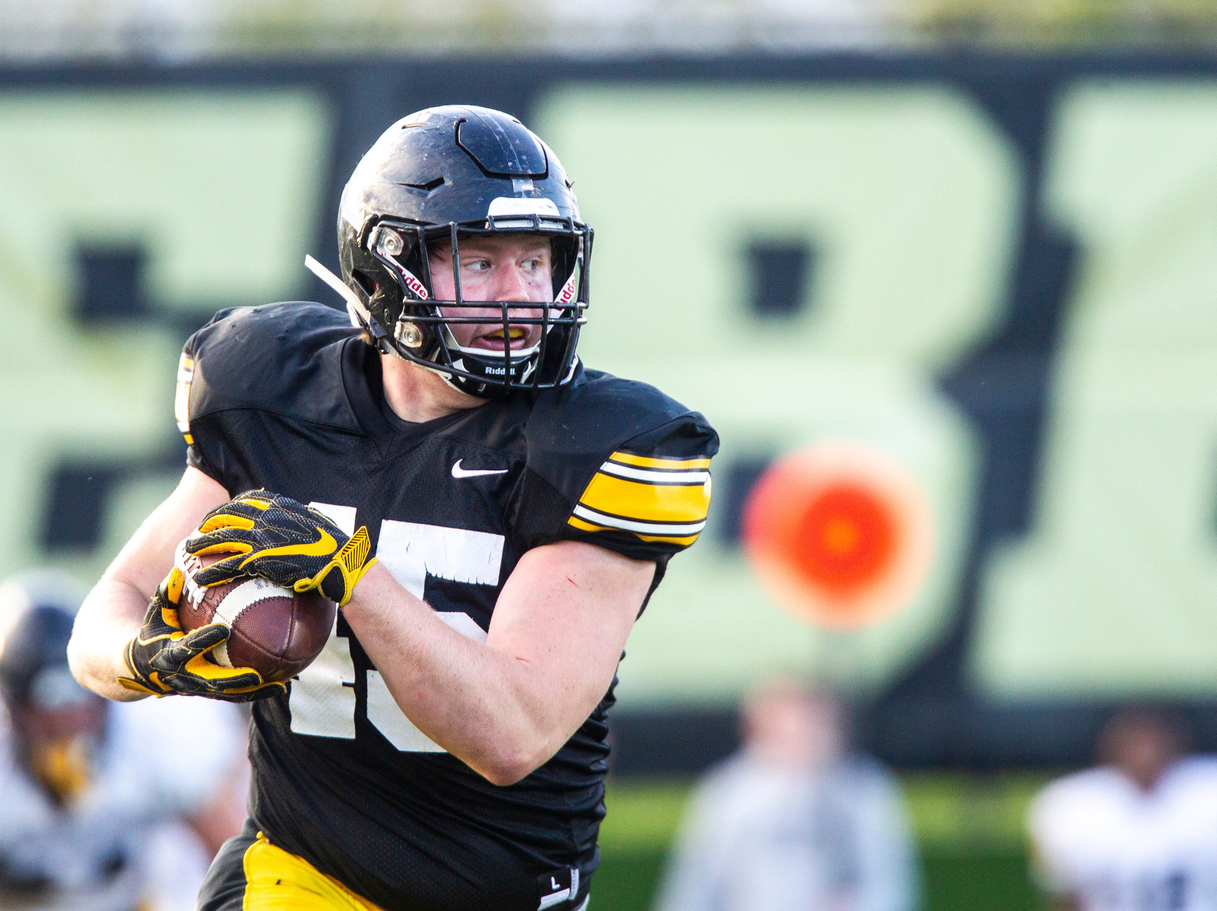Iowa fullback Joe Ludwig (45) catches a pass during the final spring football practice, Friday, April 26, 2019, at the University of Iowa outdoor practice facility in Iowa City, Iowa.