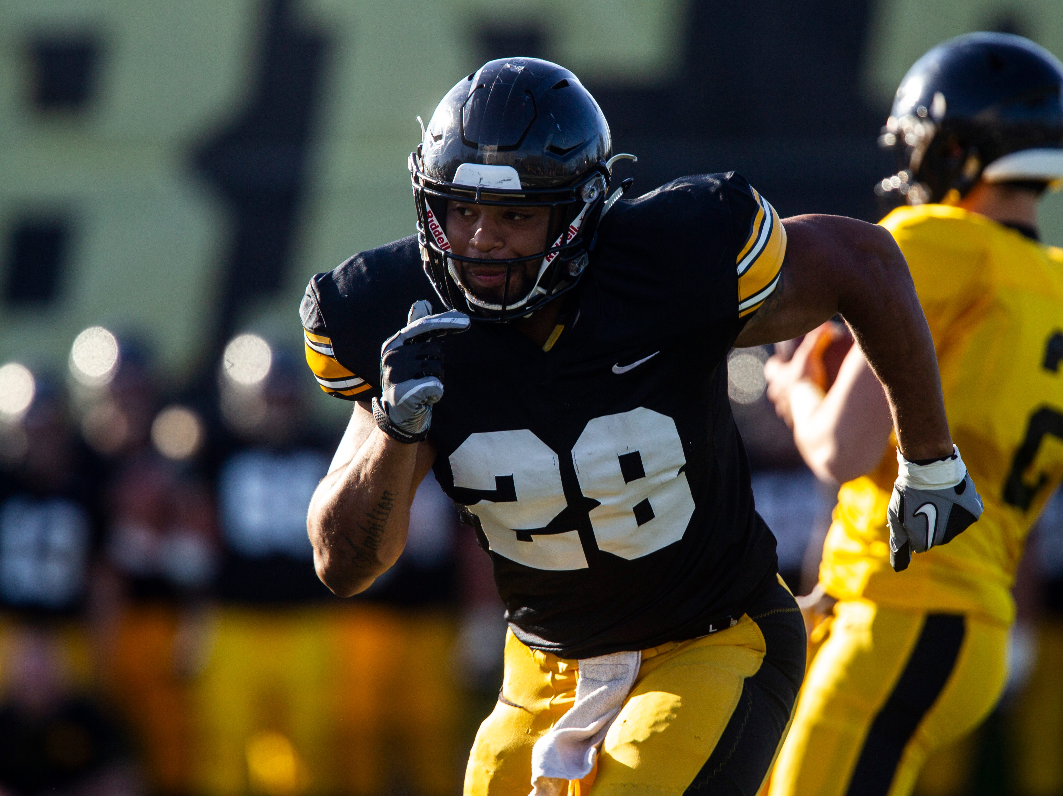Iowa running back Toren Young (28) runs a route during the final spring football practice, Friday, April 26, 2019, at the University of Iowa outdoor practice facility in Iowa City, Iowa.