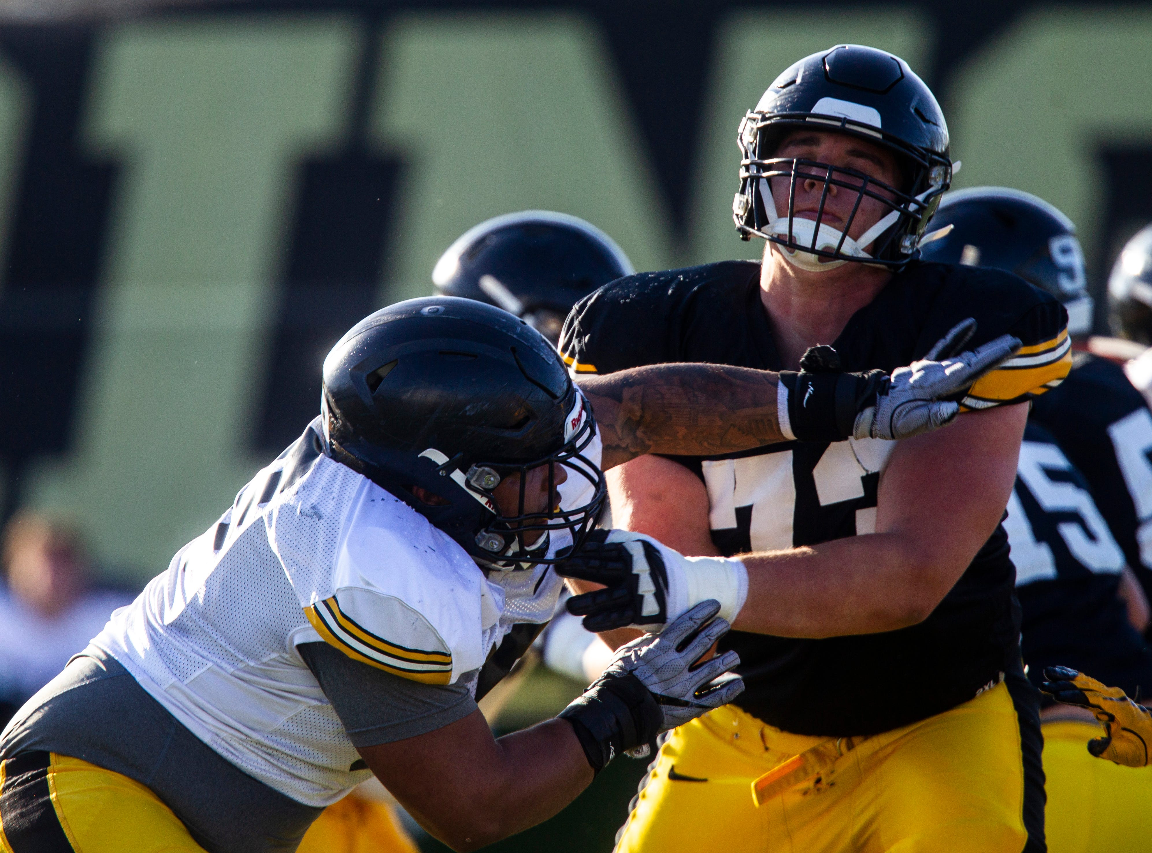 Iowa offensive lineman Cody Ince (73) blocks defensive lineman Noah Shannon (99) during the final spring football practice, Friday, April 26, 2019, at the University of Iowa outdoor practice facility in Iowa City, Iowa.