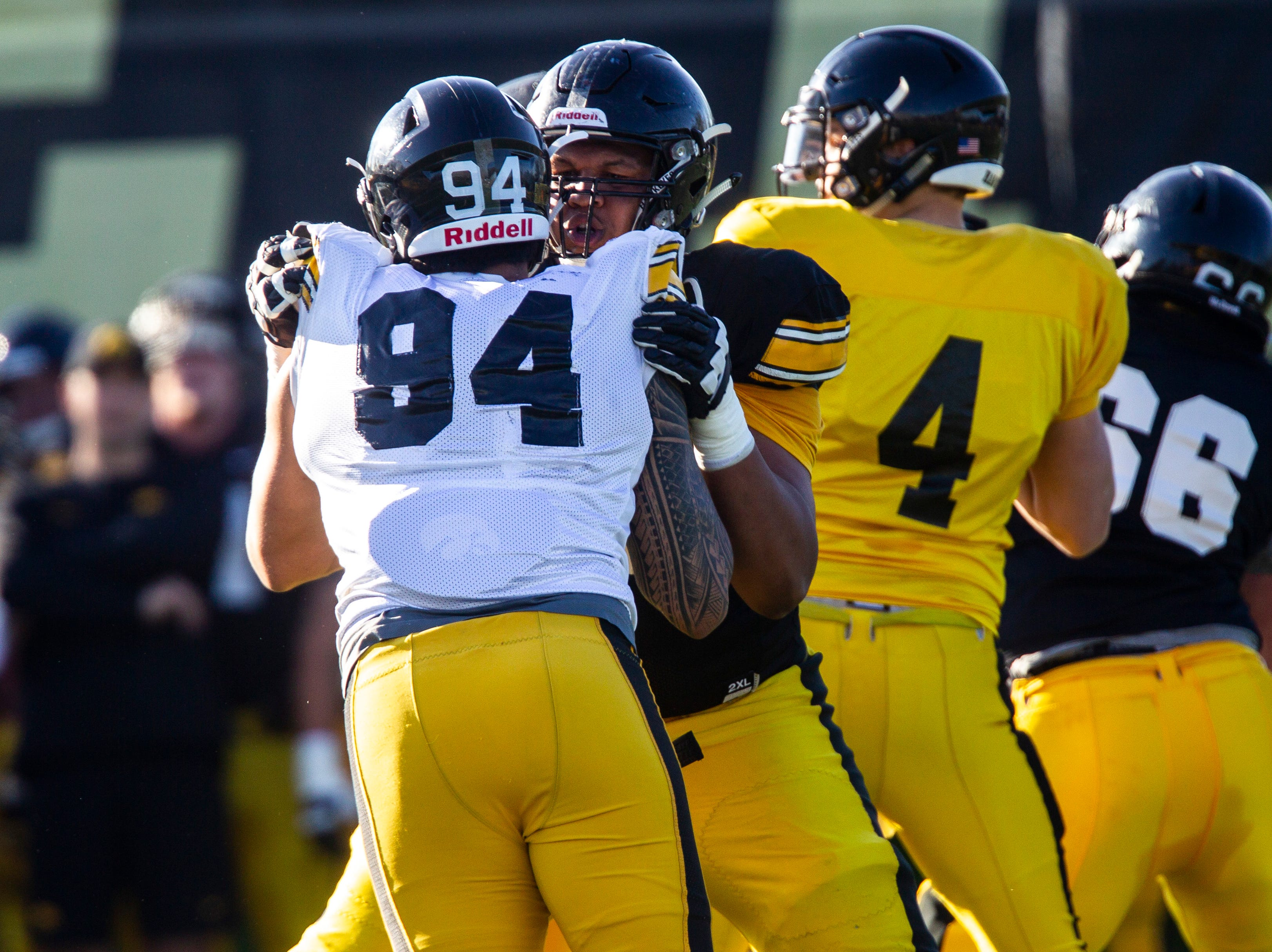 Iowa offensive lineman Alaric Jackson blocks defensive end A.J. Epenesa (94) during the final spring football practice, Friday, April 26, 2019, at the University of Iowa outdoor practice facility in Iowa City, Iowa.