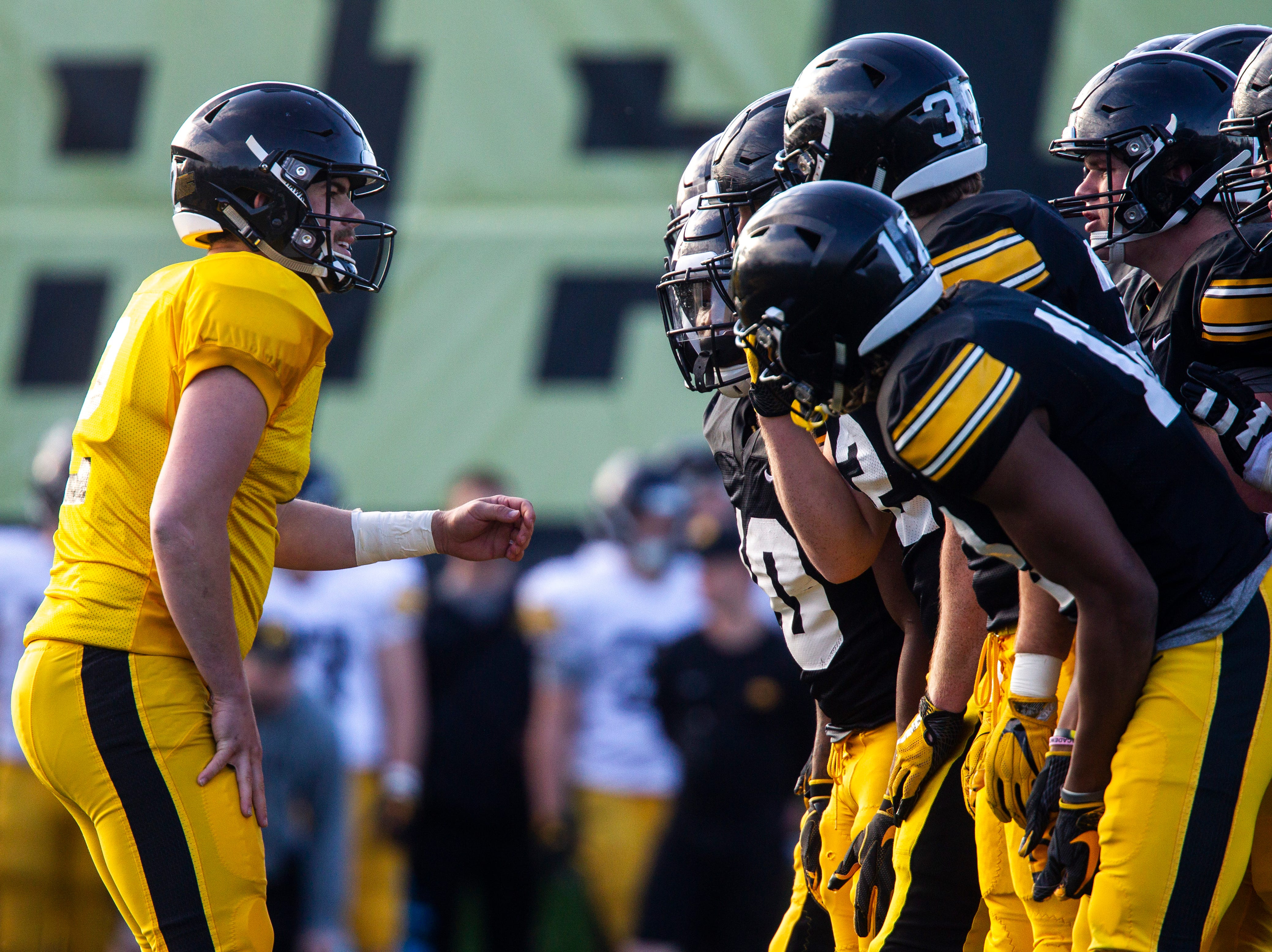 Iowa quarterback Peyton Mansell calls a play as center Tyler Linderbaum and teammates listen in during the final spring football practice, Friday, April 26, 2019, at the University of Iowa outdoor practice facility in Iowa City, Iowa.
